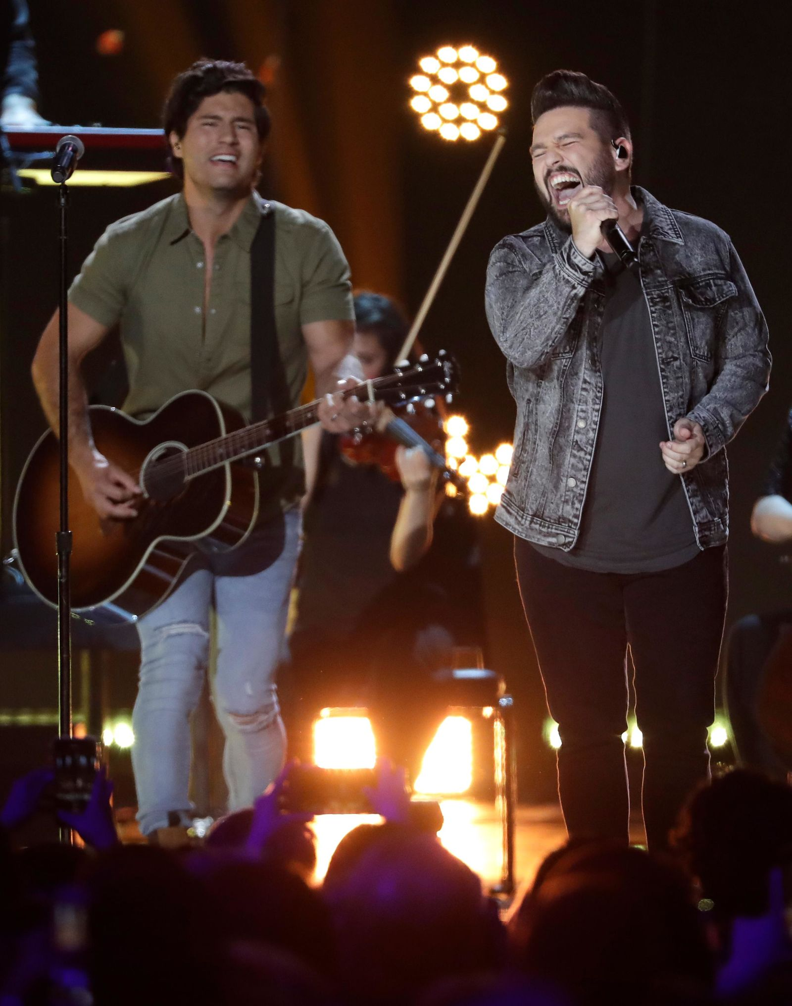 "FILE - In this June 6, 2018 file photo, Dan Smyers, left, and Shay Mooney of musical group Dan + Shay, perform ""Tequila"" at the CMT Music Awards at the Bridgestone Arena in Nashville, Tenn.{ } (AP Photo/Mark Humphrey, File)"