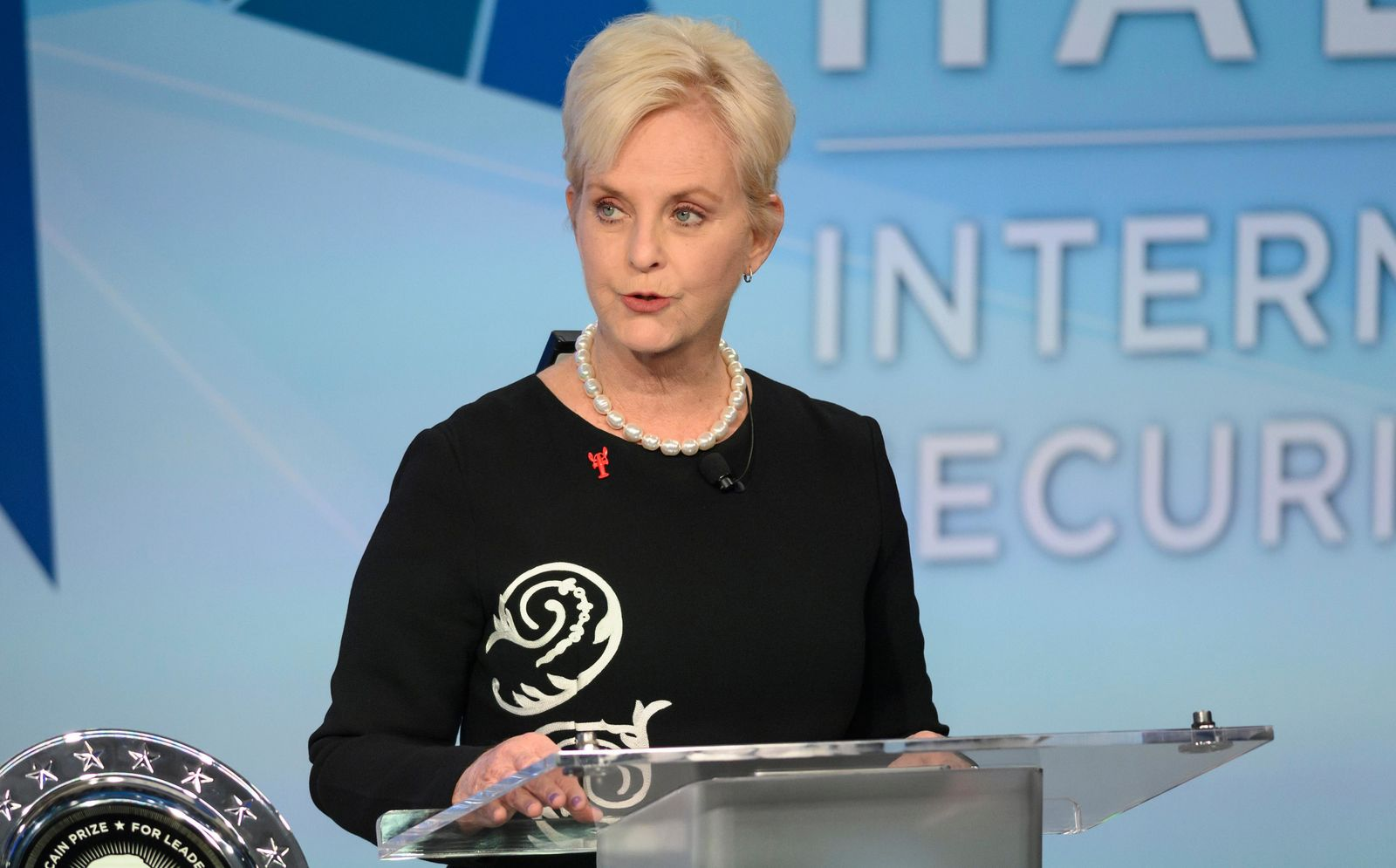 FILE - In this Nov. 17, 2018 file photo, Cindy McCain pauses while presenting the inaugural John McCain Prize for Leadership in Public Service to the People of the island of Lesbos, Greece at the Halifax International Security Forum in Halifax, Canada. (Darren Calabrese /The Canadian Press via AP)