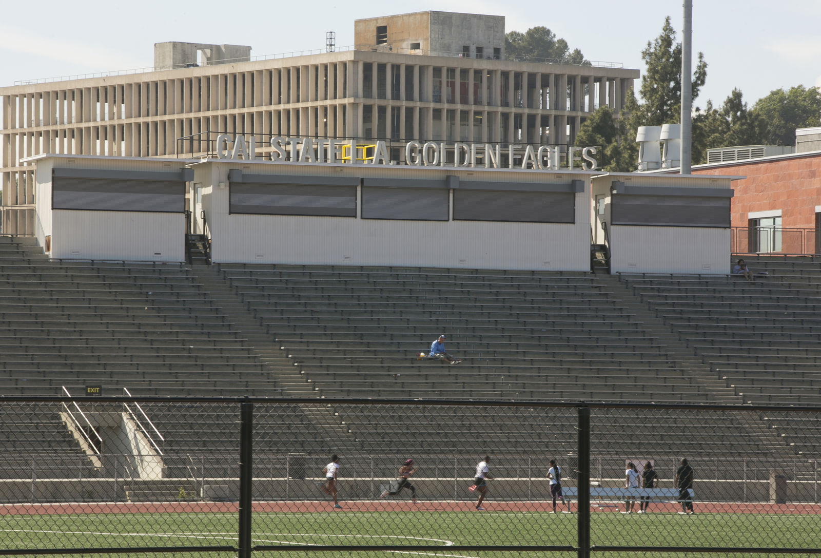 CORRECTS TO ORDER ISSUED LATE WEDNESDAY Students practice track at the Cal State University, Los Angeles campus Thursday, April 25, 2019. (AP Photo/Damian Dovarganes)