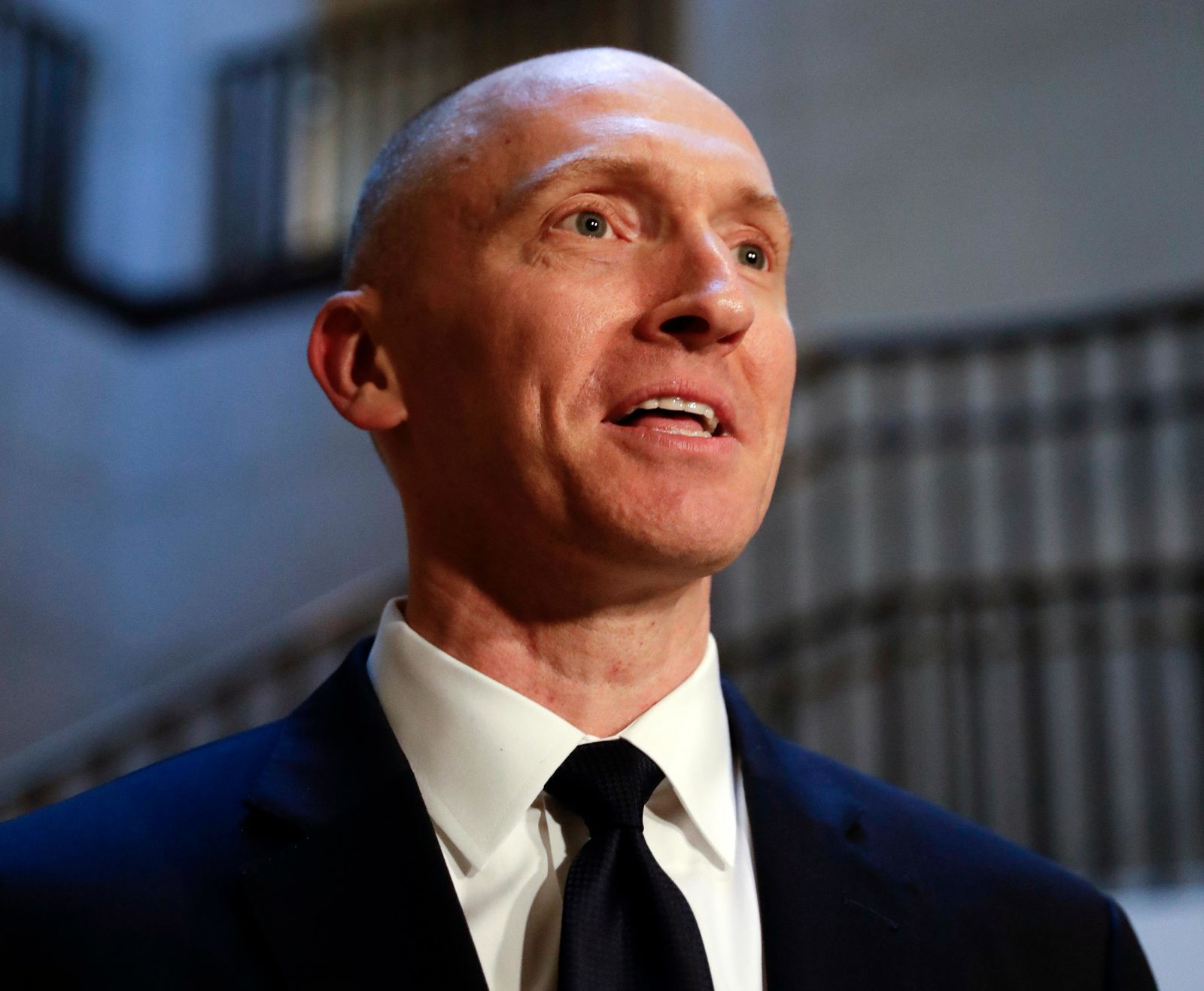 In this Nov. 2, 2017, file photo, Carter Page speaks with reporters following a day of questions from the House Intelligence Committee on Capitol Hill in Washington. A new congressional memo alleging FBI surveillance abuse is being used to undermine the legitimacy of special counsel Robert Mueller's Russia investigation. But included in the four-page document are revelations that might complicate the effort. (AP Photo/J. Scott Applewhite)