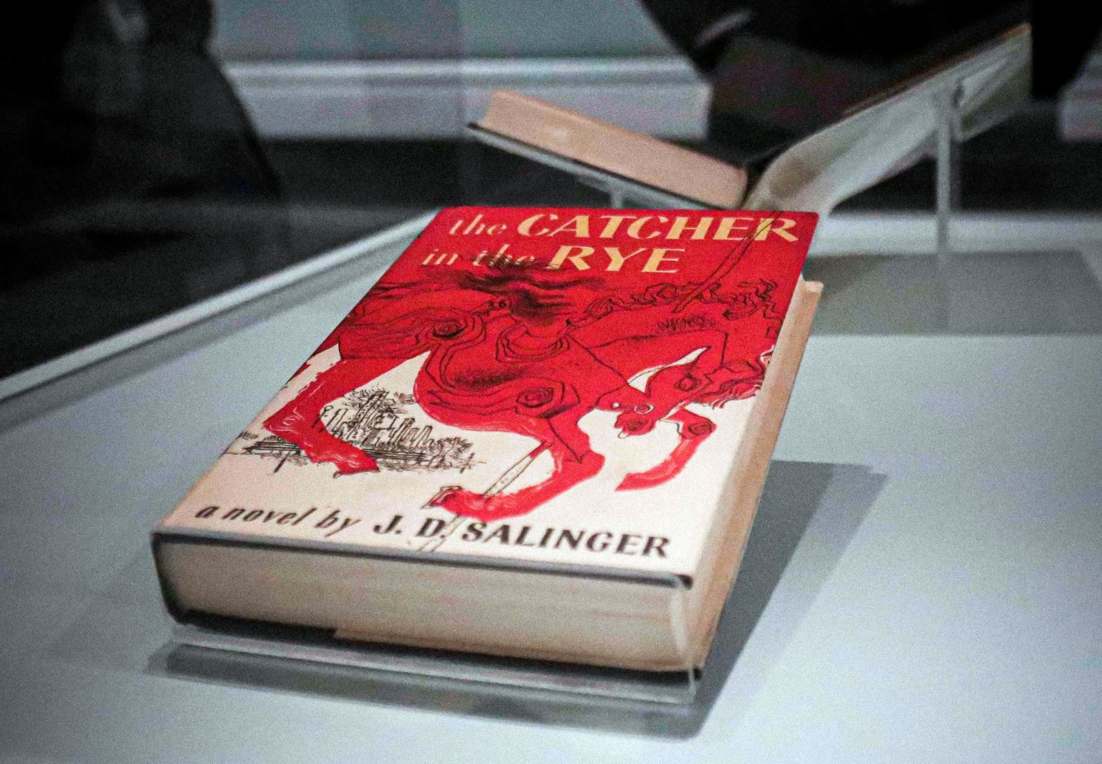 "A copy of the 1951 novel ""The Catcher in the Rye"" is part of a J.D. Salinger exhibit being installed at the New York Public Library, Wednesday, Oct. 16, 2019, in New York..  (AP Photo/Bebeto Matthews)"
