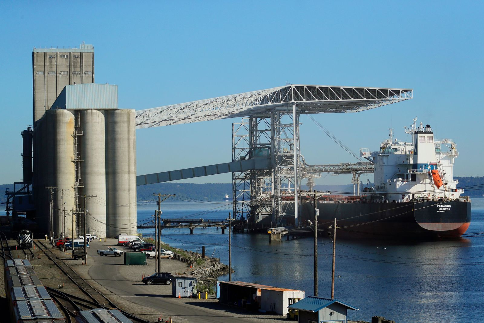 FILE - In this May 10, 2019, file photo a bulk carrier ship is loaded at the Temco grain terminal at the Port of Tacoma in Tacoma, Wash. (AP Photo/Ted S. Warren, File)