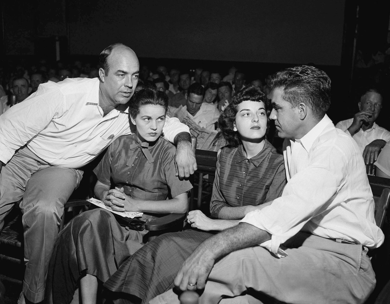 FILE - In this Sept. 23, 1955, file photo, J.W. Milam, left, his wife, second from left, Roy Bryant, far right, and his wife, Carolyn Bryant, sit together in a courtroom in Sumner, Miss. Bryant and his half-brother Milam were charged with murder but acquitted in the kidnapping and torture slaying of 14-year-old black teen Emmett Till in 1955 after he allegedly whistled at Carolyn Bryant. The government is still investigating the brutal slaying of the black teenager that helped spur the civil rights movement more than 60 years ago. A Justice Department report issued to Congress about civil rights cold case investigations lists the killing of Till as being among the unit's active cases. (AP Photo, File)