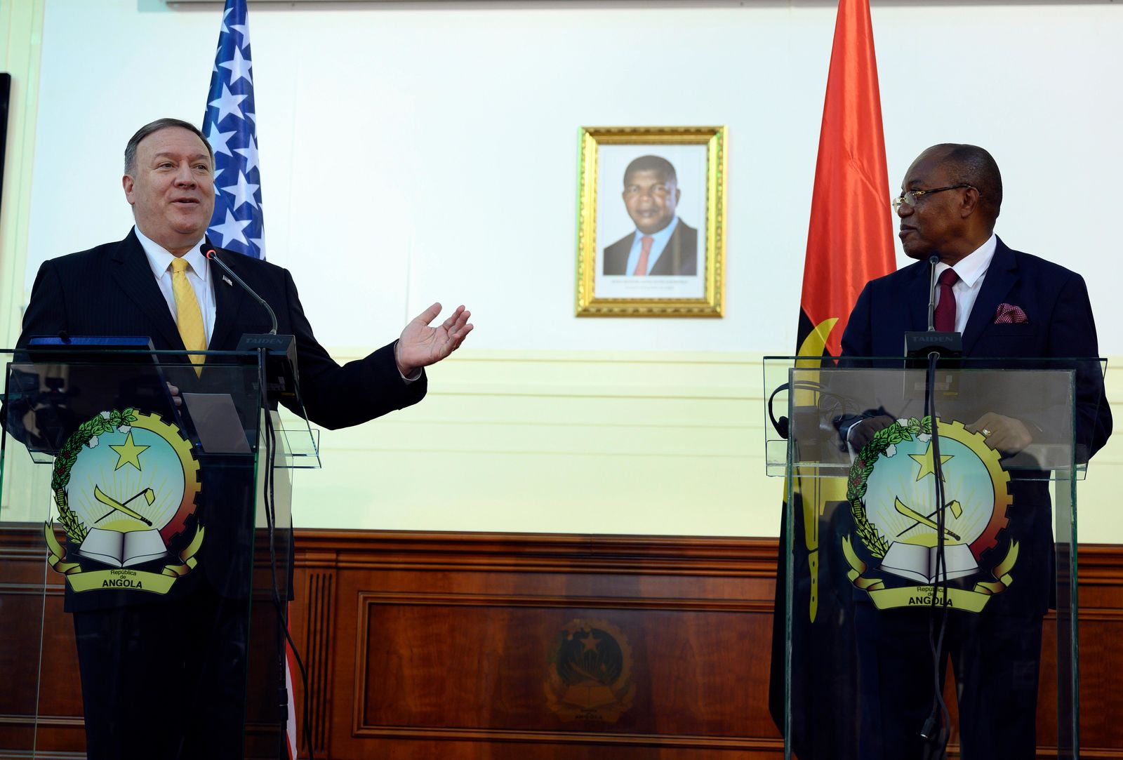US Secretary of State, Mike Pompeo, left, and Angola Foreign Minister, Manuel Domingos Augusto hold a press conference in Luanda, Angola, Monday Feb. 17, 2020. Pompeo started his tour of Africa in Senegal, the first U.S. Cabinet official to visit in more than 18 months. He left Senegal Sunday to arrive in Angola and will then travel on to Ethiopia as the Trump administration tries to counter the growing interest of China, Russia and other global powers in Africa and its booming young population of more than 1.2 billion. (Andrew Caballero-Reynolds/Pool via AP)