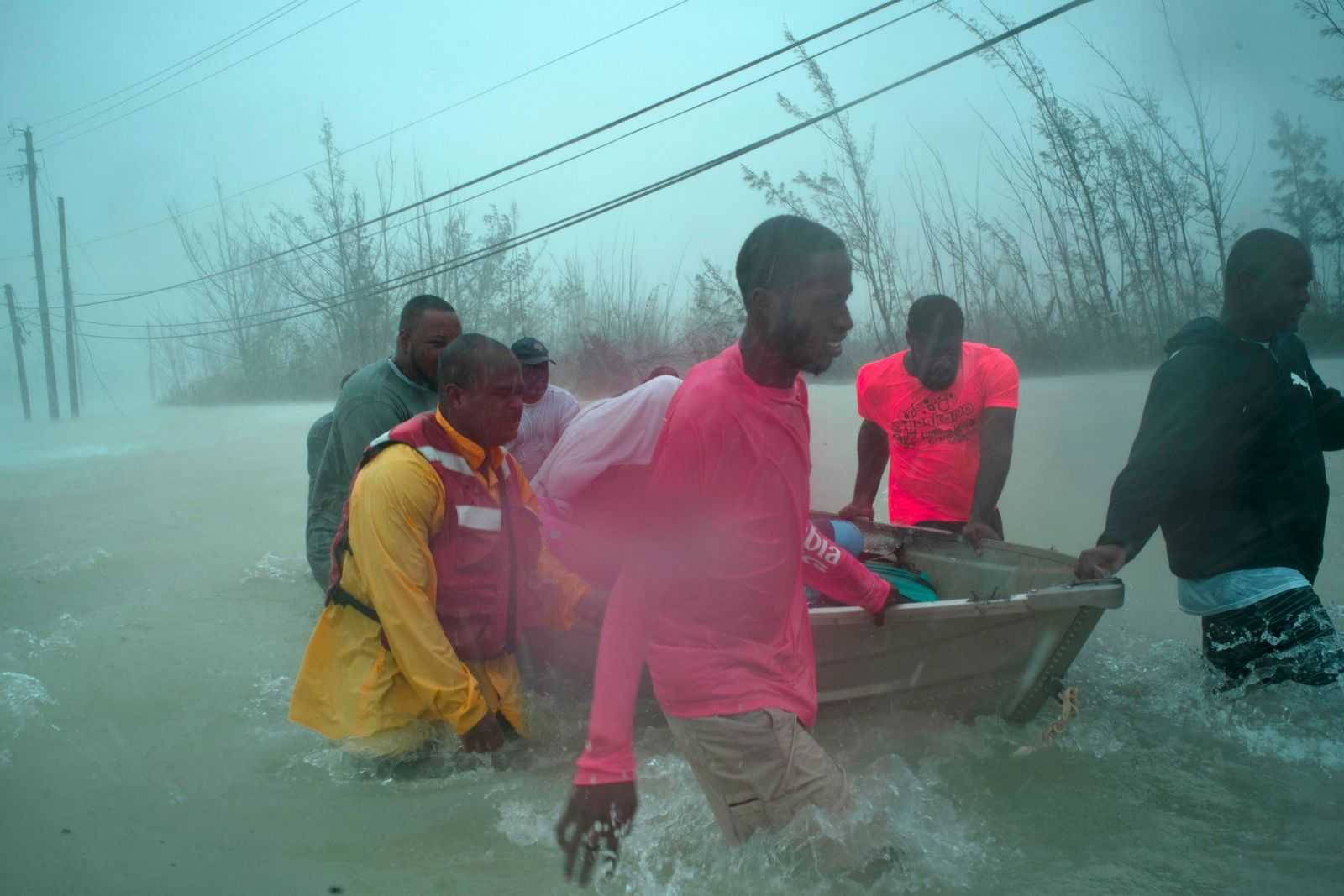 Volunteers rescue several families from the rising waters of Hurricane Dorian, near the Causarina bridge in Freeport, Grand Bahama, Bahamas, Tuesday, Sept. 3, 2019.{ } (AP Photo/Ramon Espinosa)