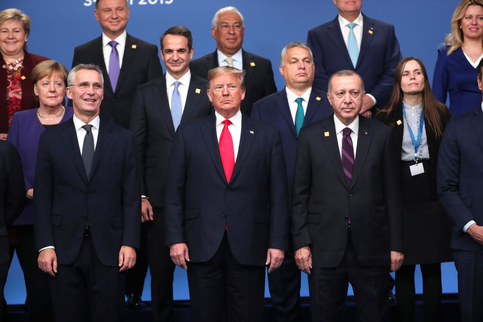 U.S. President Donald Trump, center, front, NATO Secretary General Jens Stoltenberg, center left, and Turkish President Recep Tayyip Erdogan, front right, pose with other NATO heads of state for a group photo during a NATO leaders meeting at The Grove hotel and resort in Watford, Hertfordshire, England, Wednesday, Dec. 4, 2019.. (AP Photo/Francisco Seco)