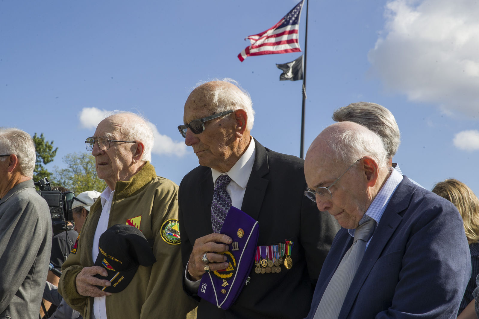 World War II veterans Clarence Smoyer, 96, left, Joseph Caserta and Buck Marsh bow their heads during a ceremony to present the Bronze Star to Smoyer at the World War II Memorial, Wednesday, Sept. 18, 2019, in Washington. Smoyer fought with the U.S. Army's 3rd Armored Division, nicknamed the Spearhead Division(AP Photo/Alex Brandon)