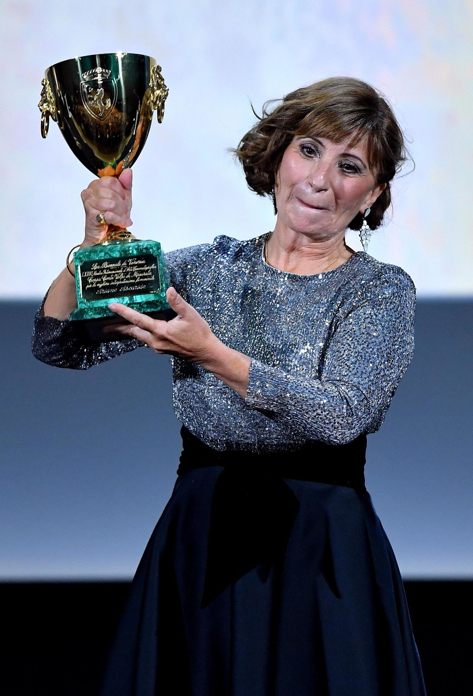 French actress and screenwriter, Ariane Ascaride holds the Volpi Cup award for the best female interpretation in the movie 'Gloria Mundi' of director Robert Guediguian during the awarding ceremony of the 76th annual Venice International Film Festival in Venice, Italy, Saturday, Sept. 7, 2019. (Ettore Ferrari/ANSA via AP)