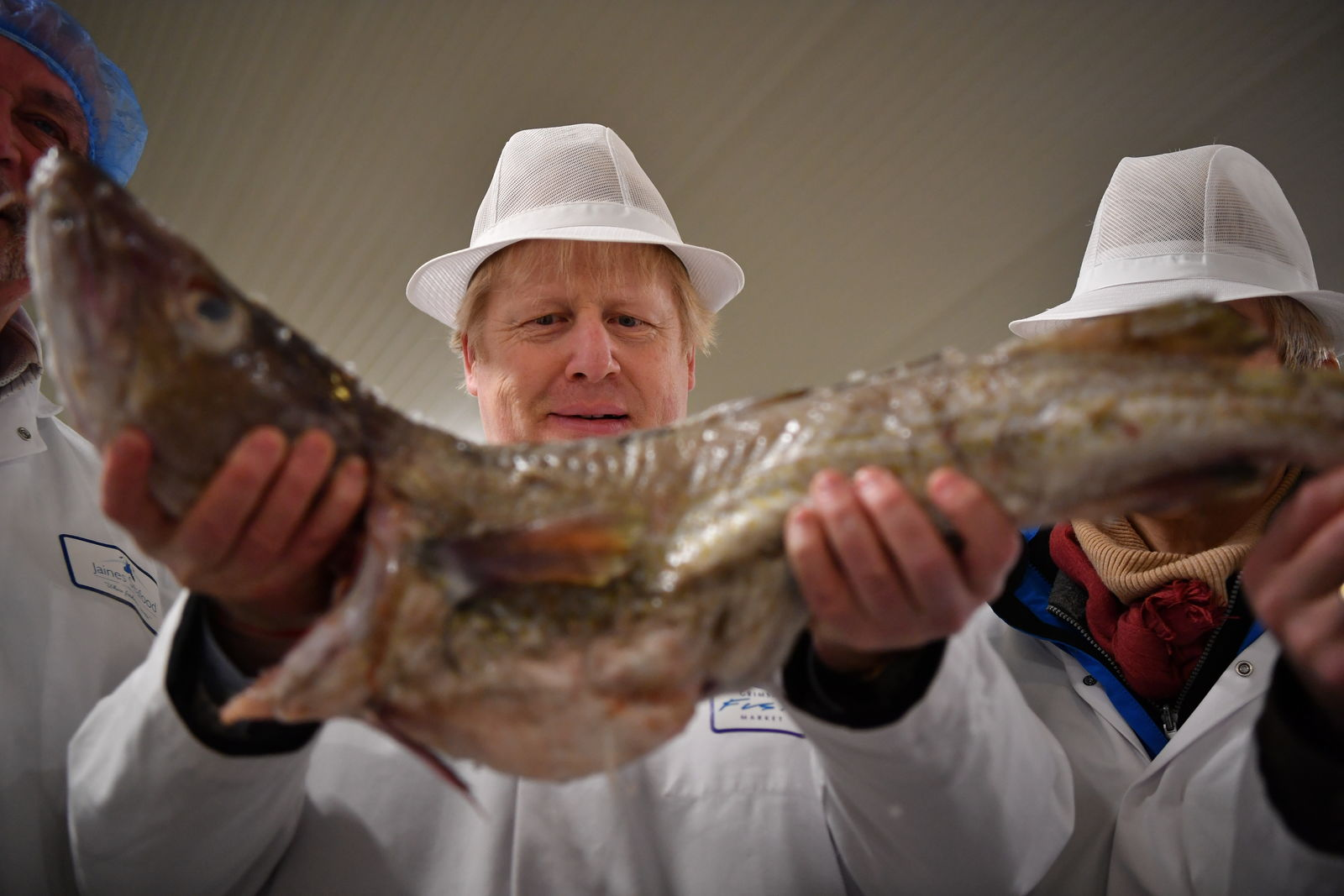 Britain's Prime Minister and Conservative Party leader Boris Johnson visits Grimsby fish market in Grimsby, northeast England, Monday Dec. 9, 2019, ahead of the general election on Dec. 12. (Ben Stansall/Pool via AP)