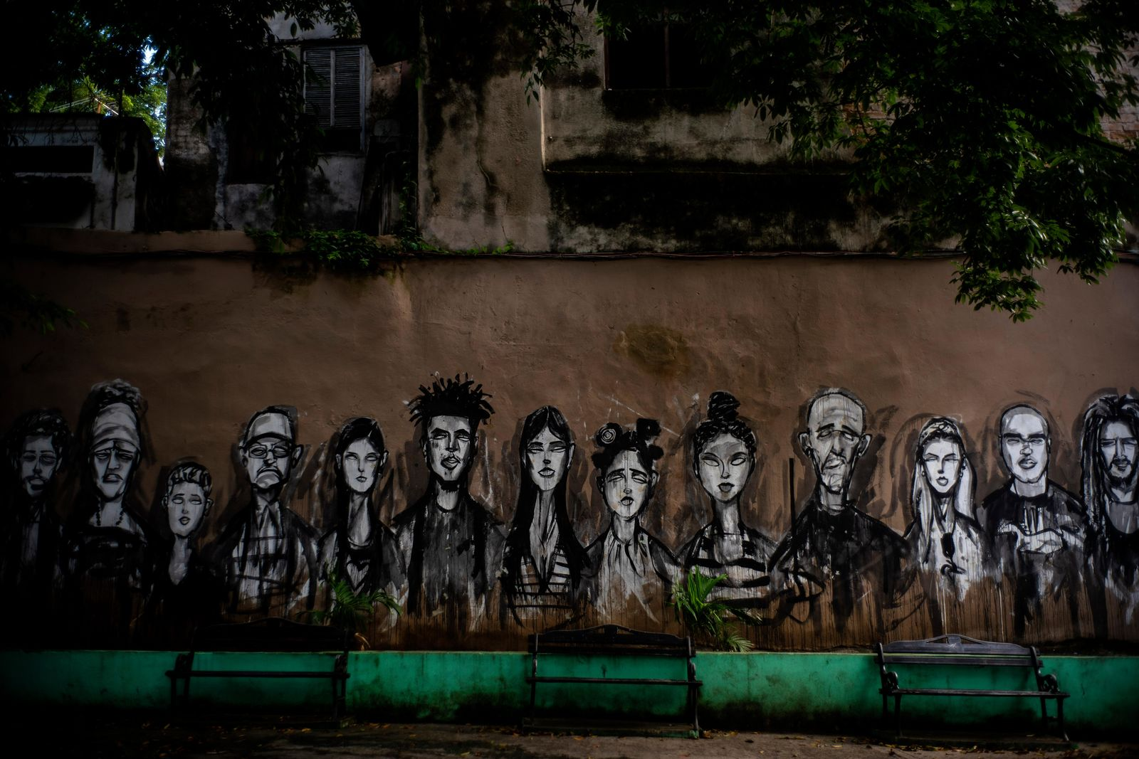 In this Nov. 10, 2019 photo, a wall is covered by a mural of faces, representing local residents, in a plaza in Old Havana, Cuba. The city will celebrate its 500th anniversary on Nov. 16. (AP Photo/Ramon Espinosa)
