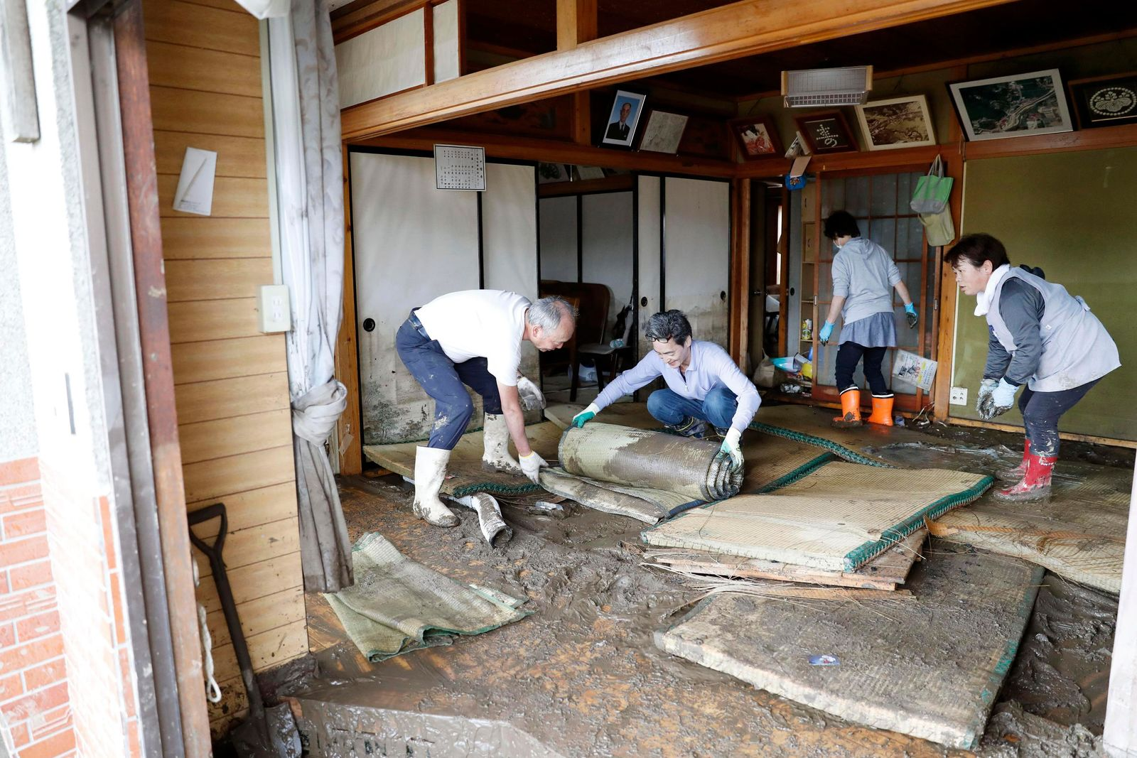 Residents clean a house damaged by Typhoon Hagibis, in Marumori town, Miyagi prefecture, Japan Monday, Oct. 14, 2019.{ } (Kyodo News via AP)