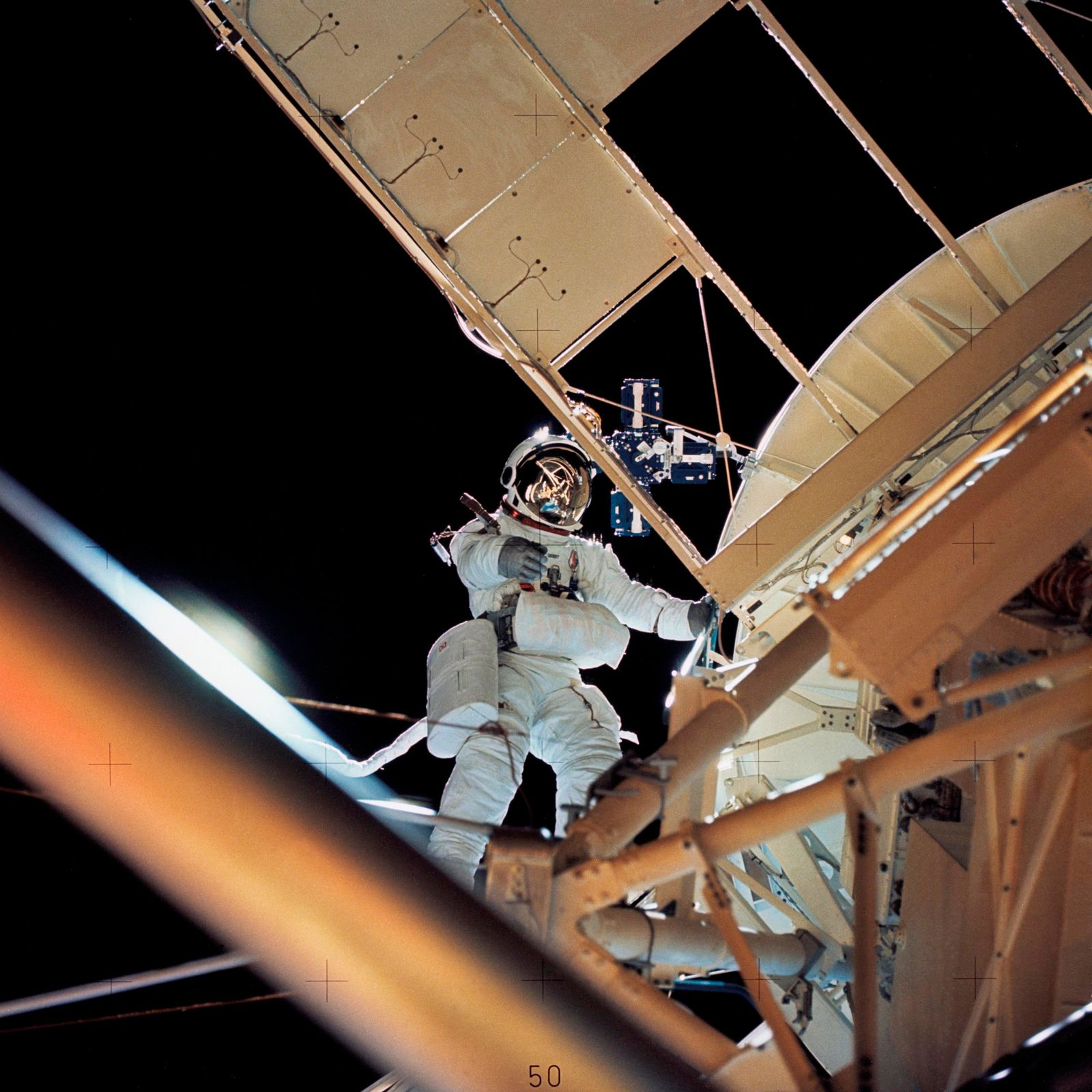 In this August 1973 photo made available by NASA, astronaut Owen K. Garriott retrieves an imagery experiment from the Apollo Telescope Mount attached to the Skylab in Earth orbit.{ } (NASA via AP)