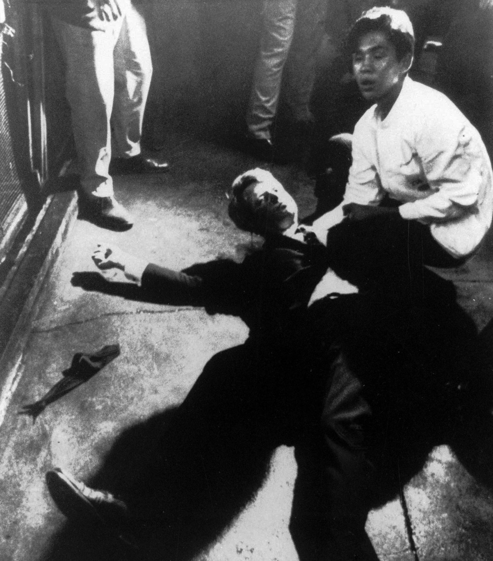 FILE - In this June 5, 1968 file photo,  Hotel busboy Juan Romero, right, comes to the aid of Senator Robert F. Kennedy,  as he lies on the floor of the Ambassador hotel in Los Angeles moments after he was shot. (Boris Yaro/Los Angeles Times via AP)