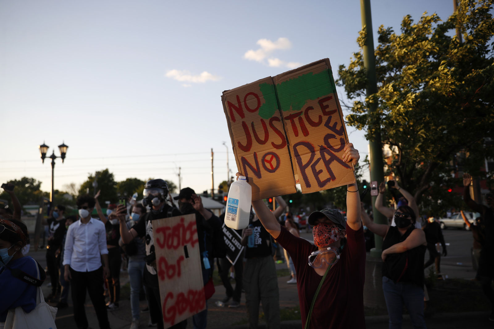 Police cars burn, windows shatter as protests roil New ... |Minneapolis Protests Washburn