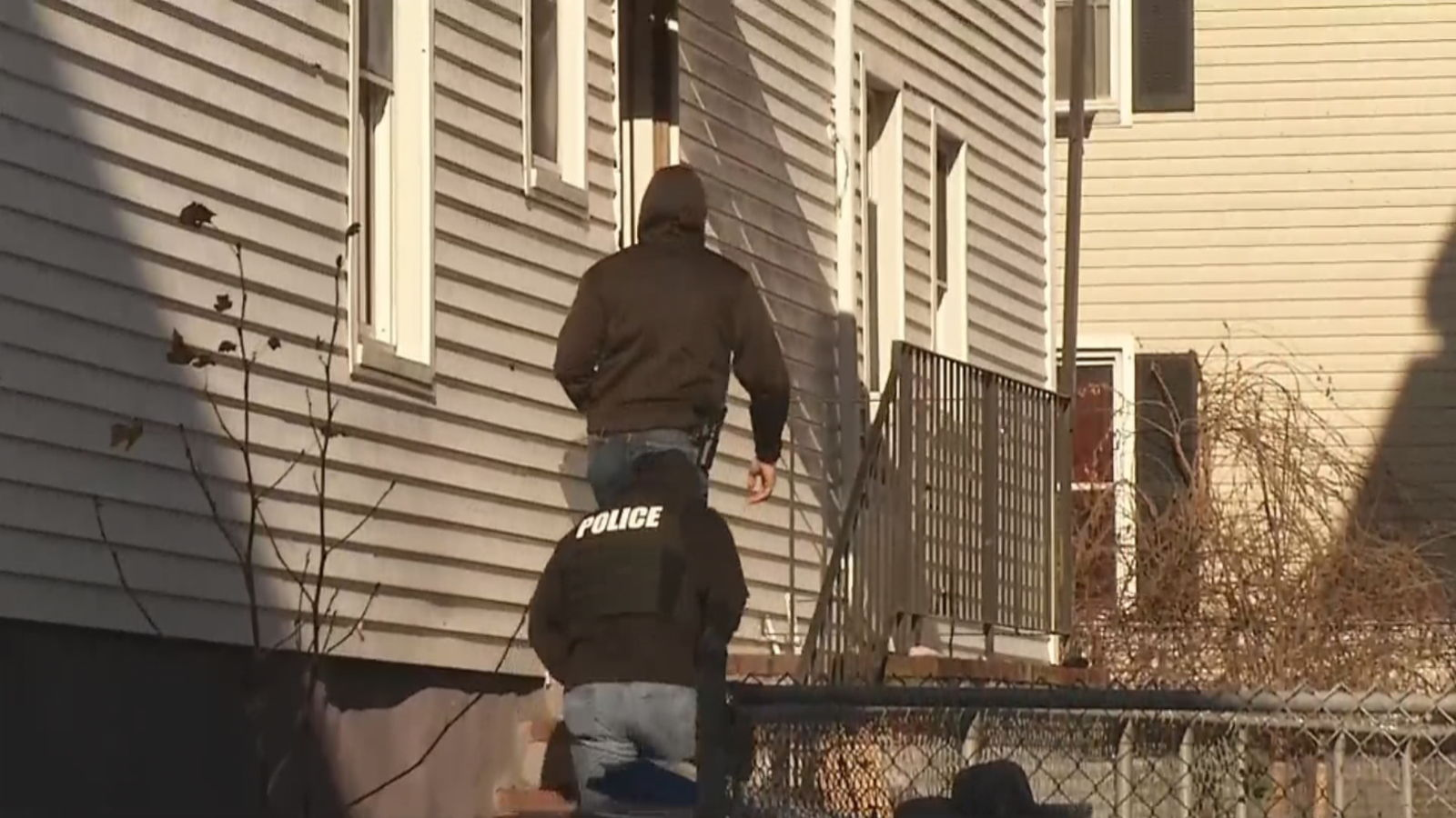 FBI agents and police officers are seen taking documents from a house on North Front Street in New Bedford as part of an investigation into the Latin Kings, Dec. 5, 2019. (WJAR)