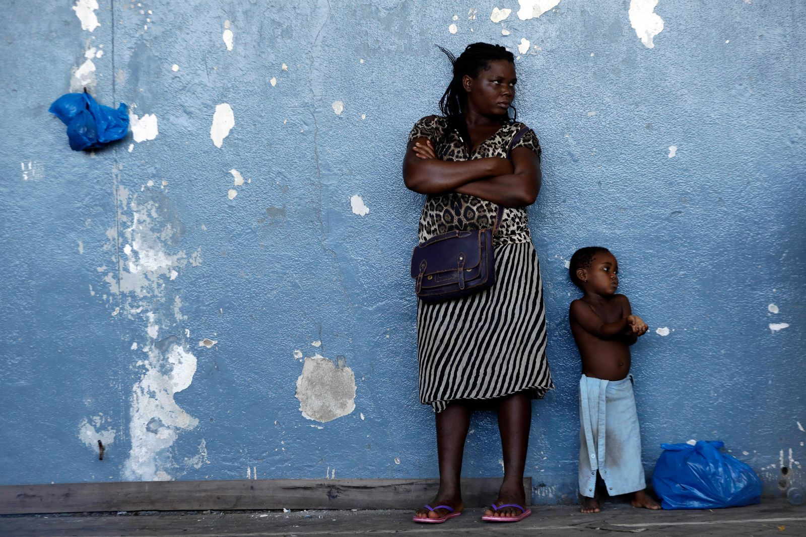 A woman and her child send against the wall at a displacement centre in Beira, Mozambique, Friday, March 22, 2019. y(AP Photo/Themba Hadebe)