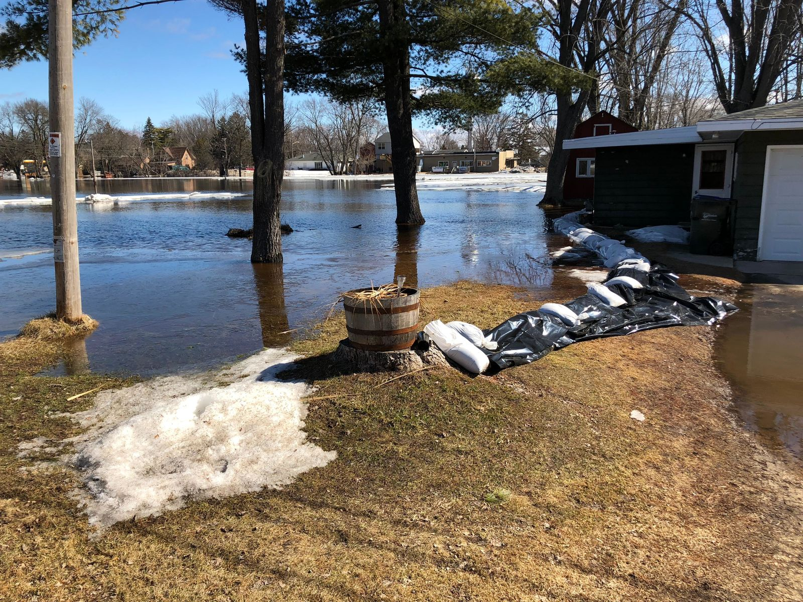 Sandbags are piled along the Wolf River in Shiocton March 22, 2019. (WLUK/Eric Peterson)
