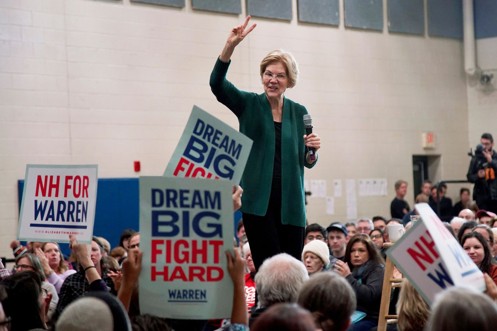 Democratic presidential candidate Sen. Elizabeth Warren, D-Mass., holds up two fingers as she speaks during a campaign stop, Saturday, Nov. 23, 2019, in Manchester, N.H. (AP Photo/Mary Schwalm)