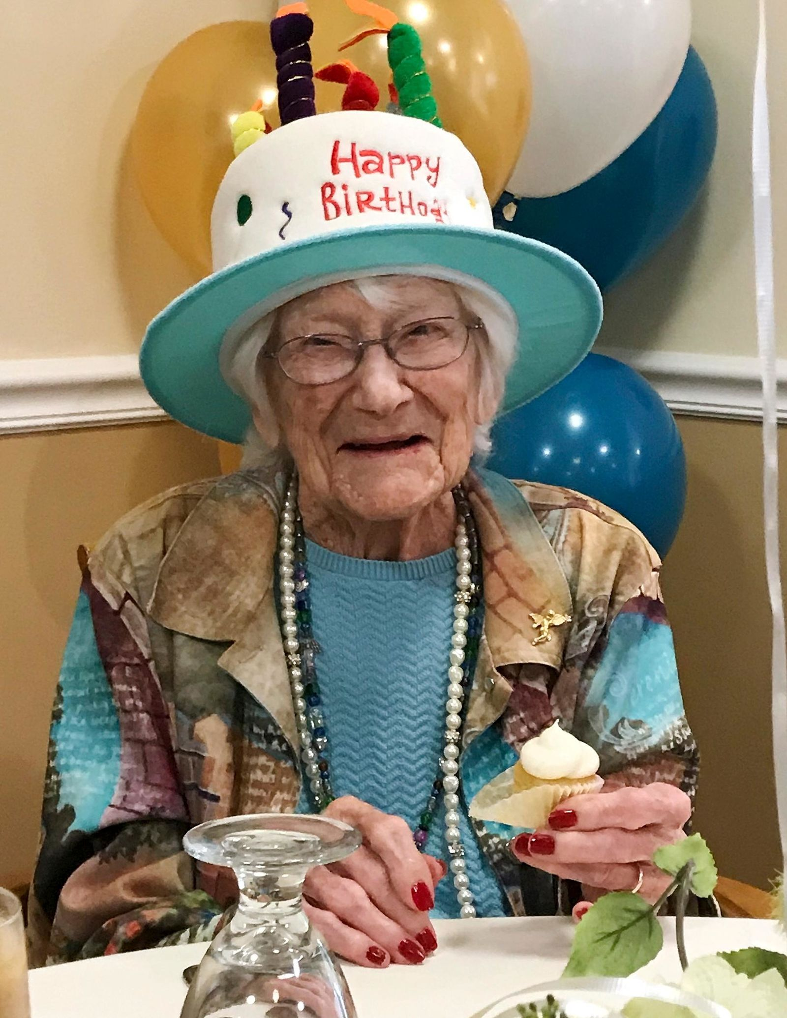 In this photo provided by Tony Venti, Hazel Nilson celebrates her 111th birthday with a peach cupcake, Wednesday, Aug. 21, 2019, at Sunapee Cove in Sunapee, N.H. (Tony Venti via AP)