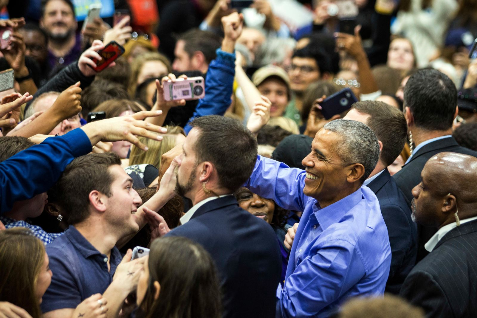Former President Barack Obama greets people at a rally for Illinois Democrats, Sunday, Nov. 4, 2018, at the University of Illinois at Chicago, in Chicago. (Ashlee Rezin/Chicago Sun-Times via AP)
