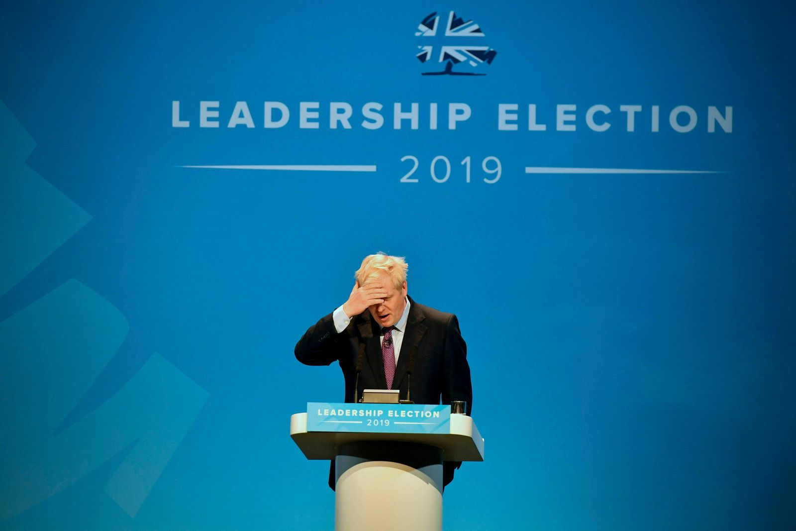 Conservative party leadership candidate Boris Johnson gestures, during the first party hustings at the ICC in Birmingham, England, Saturday June 22, 2019. (Ben Birchall/PA via AP)