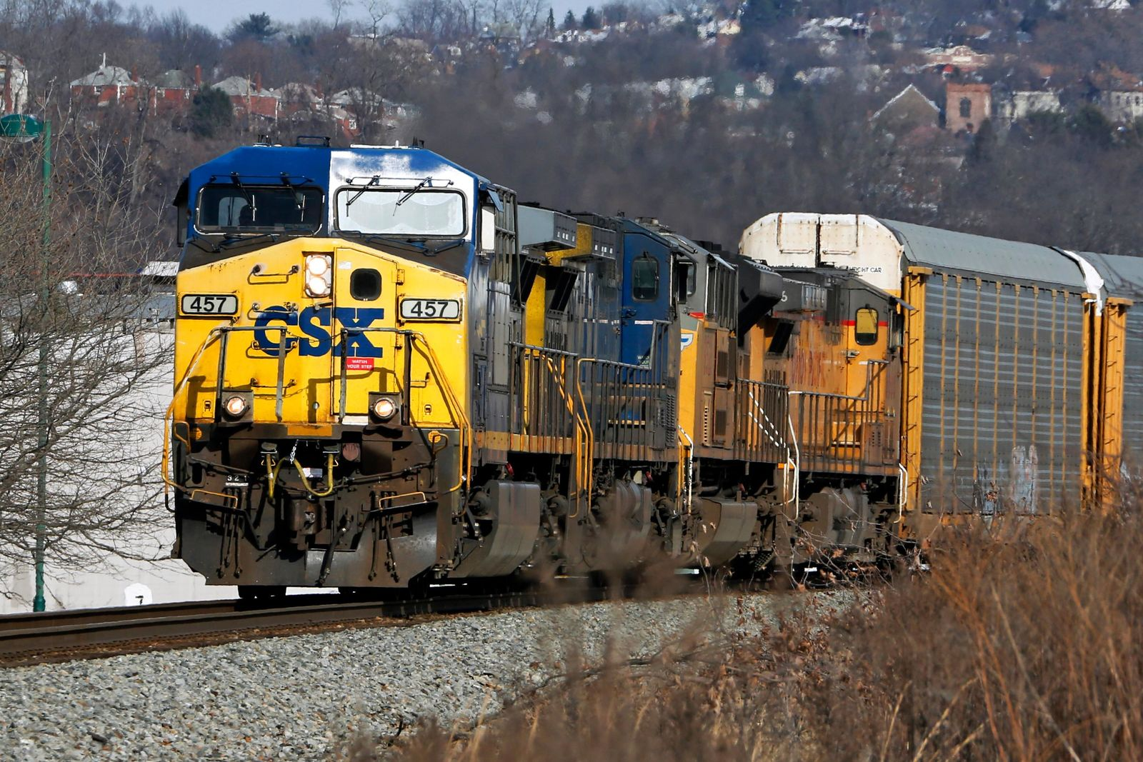 FILE- In this Feb. 12, 2018 file photo a CSX Transportation Inc. freight train passes through Homestead, Pa. More than two dozen major companies ranging from Campbell Soup to Kia filed anti-trust lawsuits on Sept. 30, 2019 against the nation's four largest railway companies, contending the railroads had a price-fixing scheme to illegally boost profits.(AP Photo/Gene J. Puskar, File)