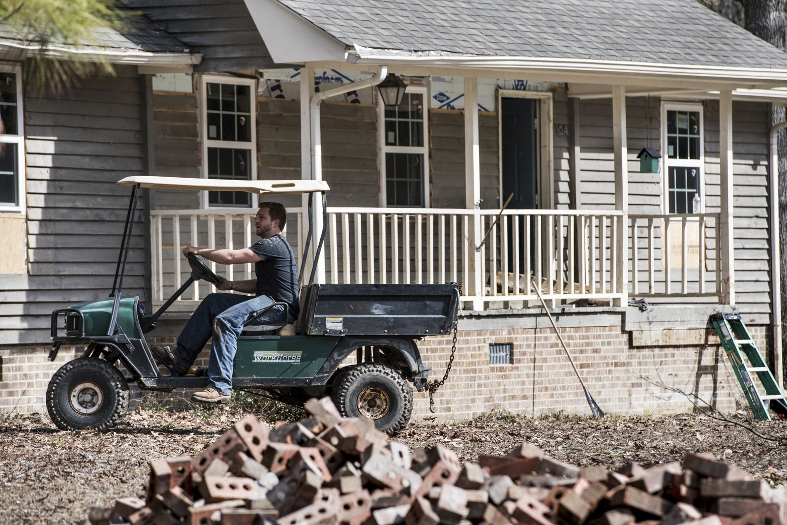 Austin Black works to repair a home damaged by flooding from Hurricane Florence near the Crabtree Swamp Friday, Feb. 1, 2019, in Conway, S.C.{ } (AP Photo/Sean Rayford)