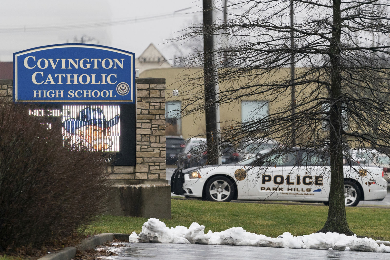 A police car sits at the entrance to Covington Catholic High School in Park Hills, Ky., Saturday, Jan 19, 2019.{ } (AP Photo/Bryan Woolston)