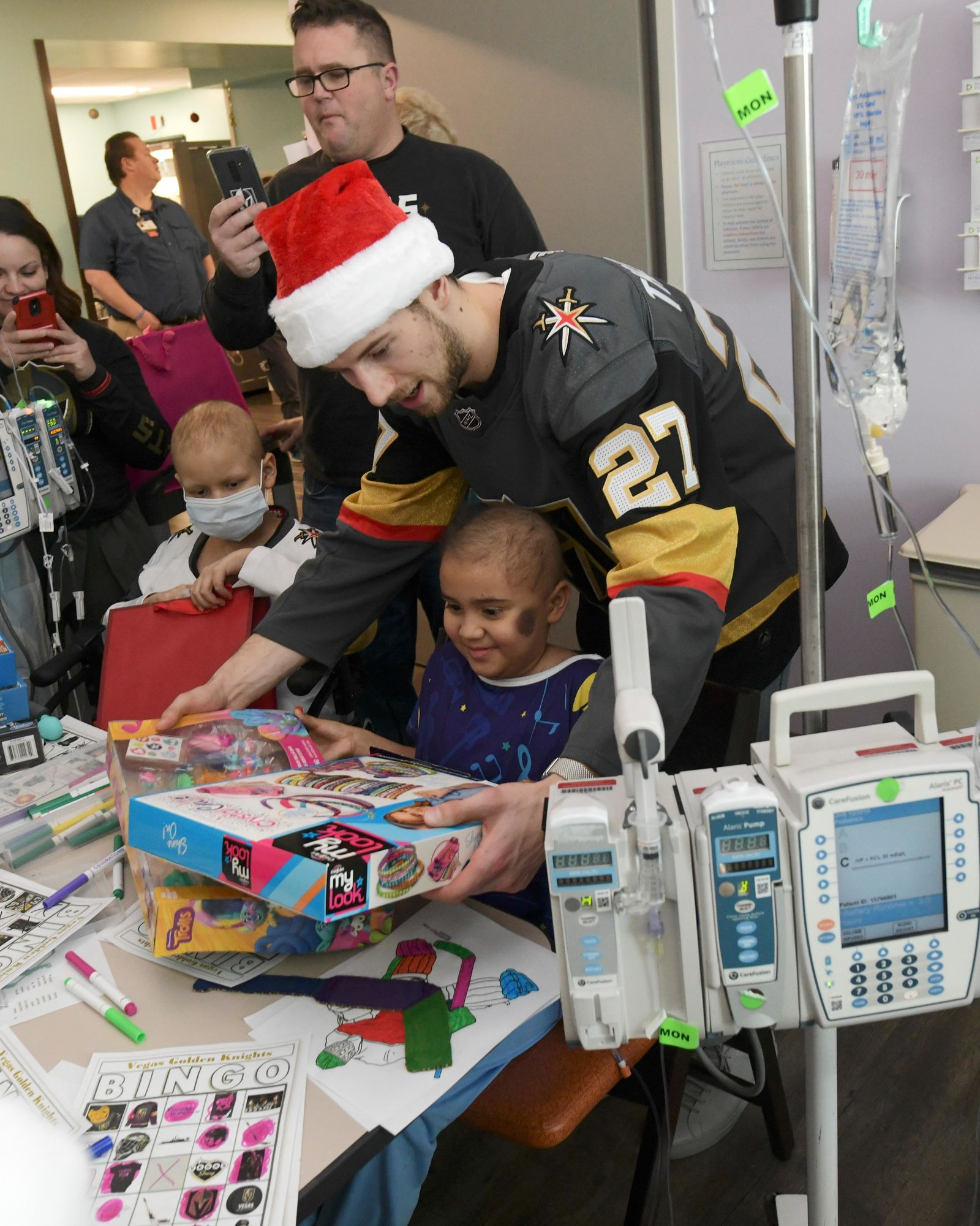 Vegas Golden Knights defenseman Shea Theodore gives presents to a young patient during a visit to Summerlin Hospital Friday, December 21, 2018. CREDIT: Sam Morris/Las Vegas News Bureau