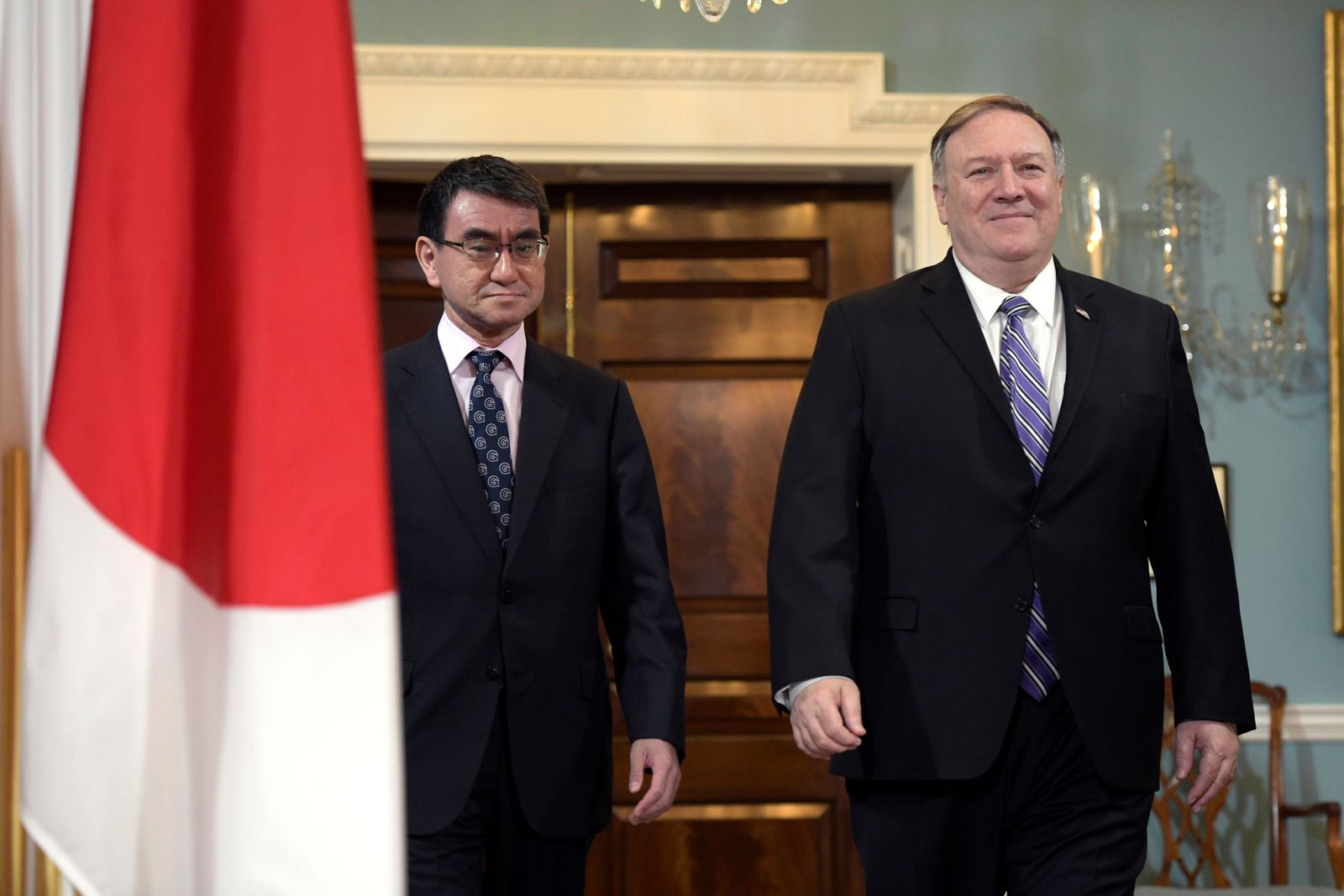 Secretary of State Mike Pompeo, right, arrives with Japanese Foreign Minister Taro Kono on Friday, April 19, 2019, at the Department of State in Washington. (AP Photo/Sait Serkan Gurbuz)