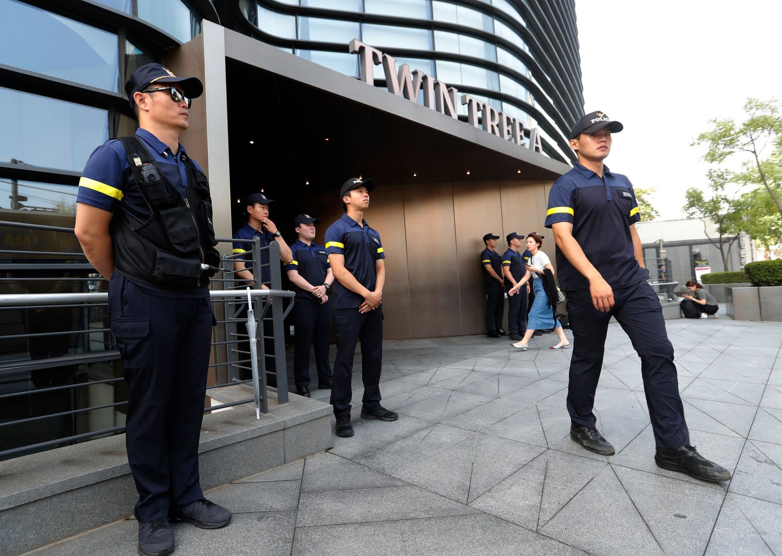 South Korean police officers stand guard against possible rallies against Japan in front of a building where the Japanese embassy is located in Seoul, South Korea, Friday, July 19, 2019.{ } (AP Photo/Ahn Young-joon)