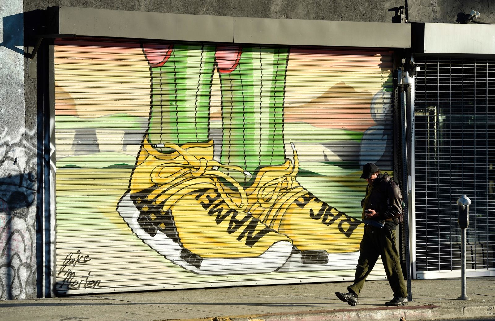 "This Jan. 9, 2019 photo shows a pedestrian walking past a mural by artist Jake Merten inspired by the ""Dragon Ball"" anime series  in Los Angeles.{ } (AP Photo/Chris Pizzello)"