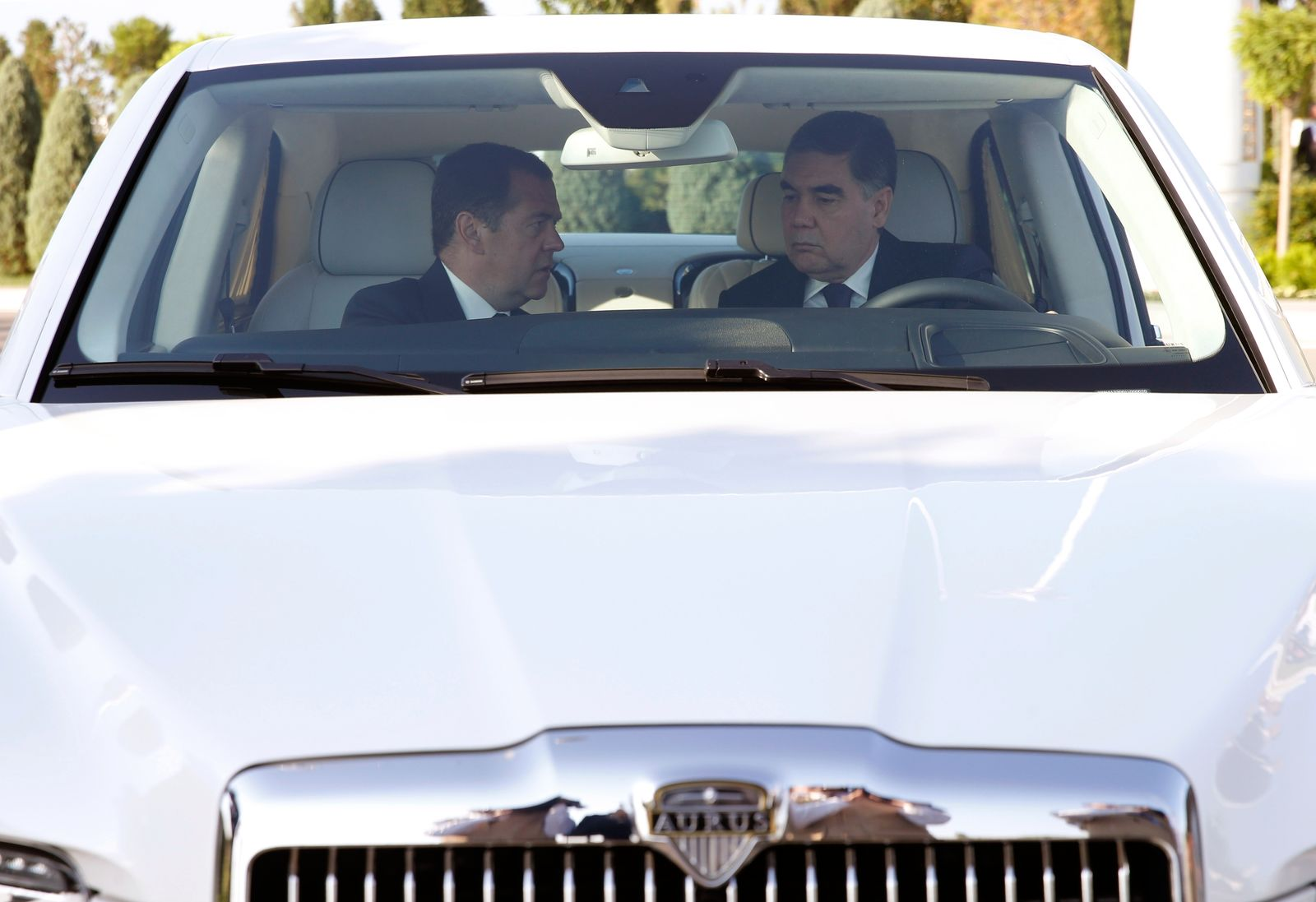Russian Prime Minister Dmitry Medvedev, left, and Turkmenistan's President Gurbanguly Berdymukhamedov sit inside the Russian made limousine Aurus Senat prior to a session of the First Caspian Economic Forum in Turkmenbashi, Turkmenistan, Monday, Aug. 12, 2019. (Dmitry Astakhov, Sputnik, Government Pool Photo via AP)