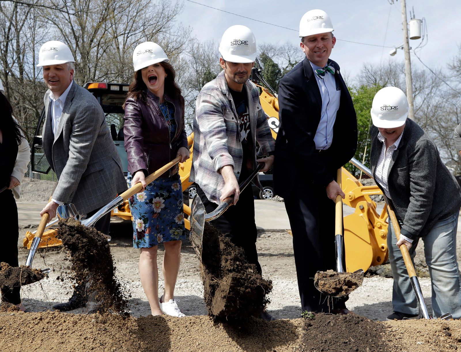 Country music star Brad Paisley, center, and his wife, actress Kimberly Williams-Paisley, second from left, take part in the groundbreaking ceremony for The Store, a free grocery store for people in need, Wednesday, April 3, 2019, in Nashville, Tenn. (AP Photo/Mark Humphrey)