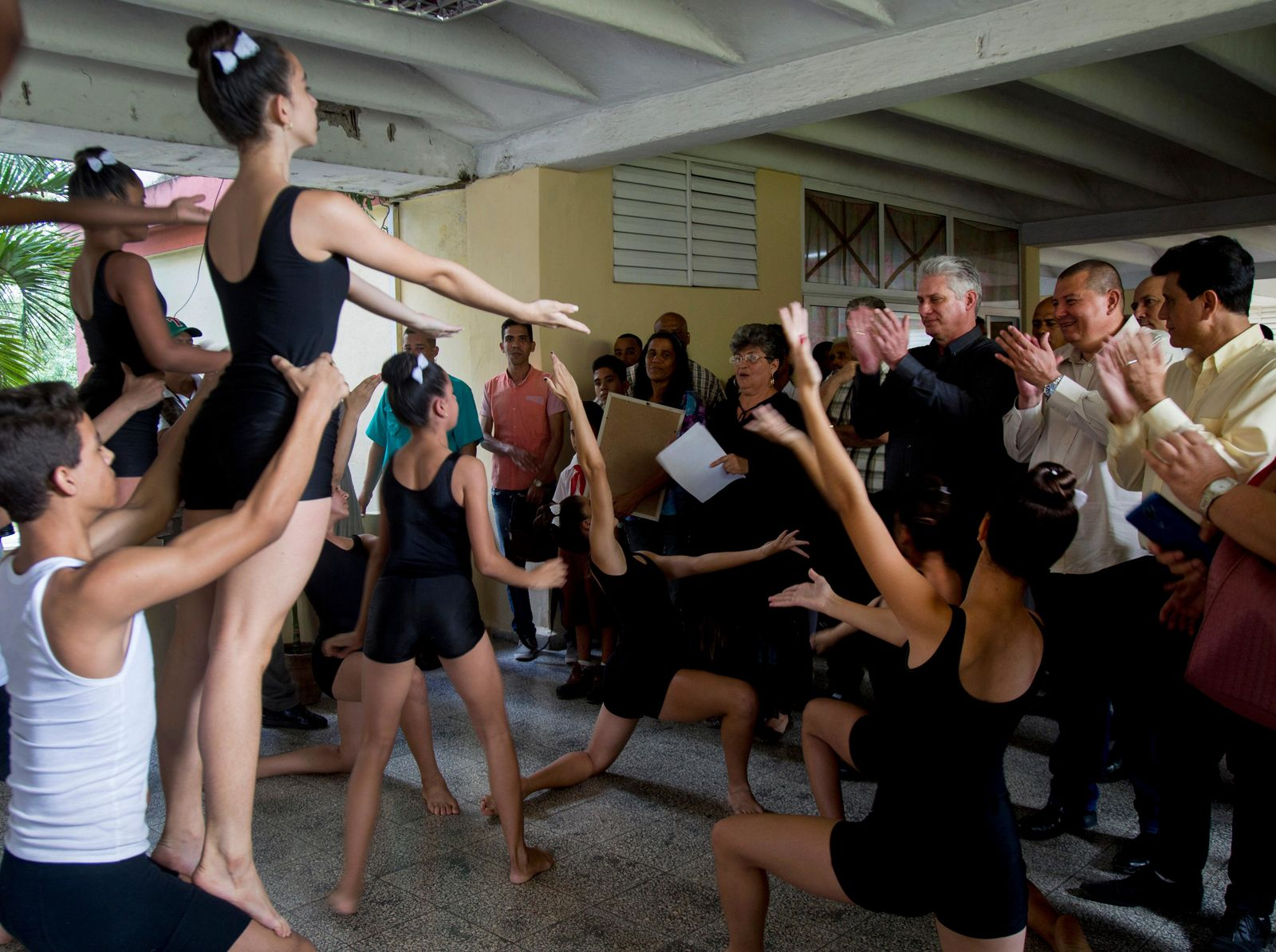 Cuba's President Miguel Diaz-Canel, third right, attends a dance demonstration at an art school during a tour in Las Tunas, Cuba, Thursday, Jan. 16, 2020. (AP Photo / Ismael Francisco)