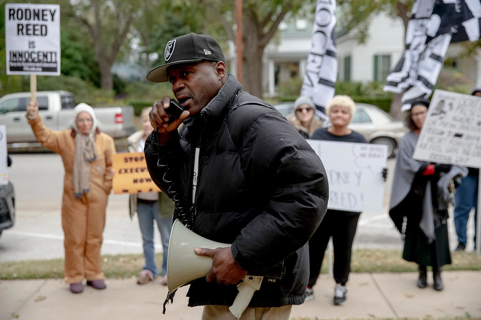Rodrick Reed leads a chant during a protest against the execution of Rodney Reed on Wednesday, Nov. 13, 2019, in Bastrop, Texas. Reed is scheduled to be executed Nov. 20, but a growing number of politicians and celebrities have joined calls to further examine Reed's case before his execution proceeds. (Nick Wagner/Austin American-Statesman via AP)