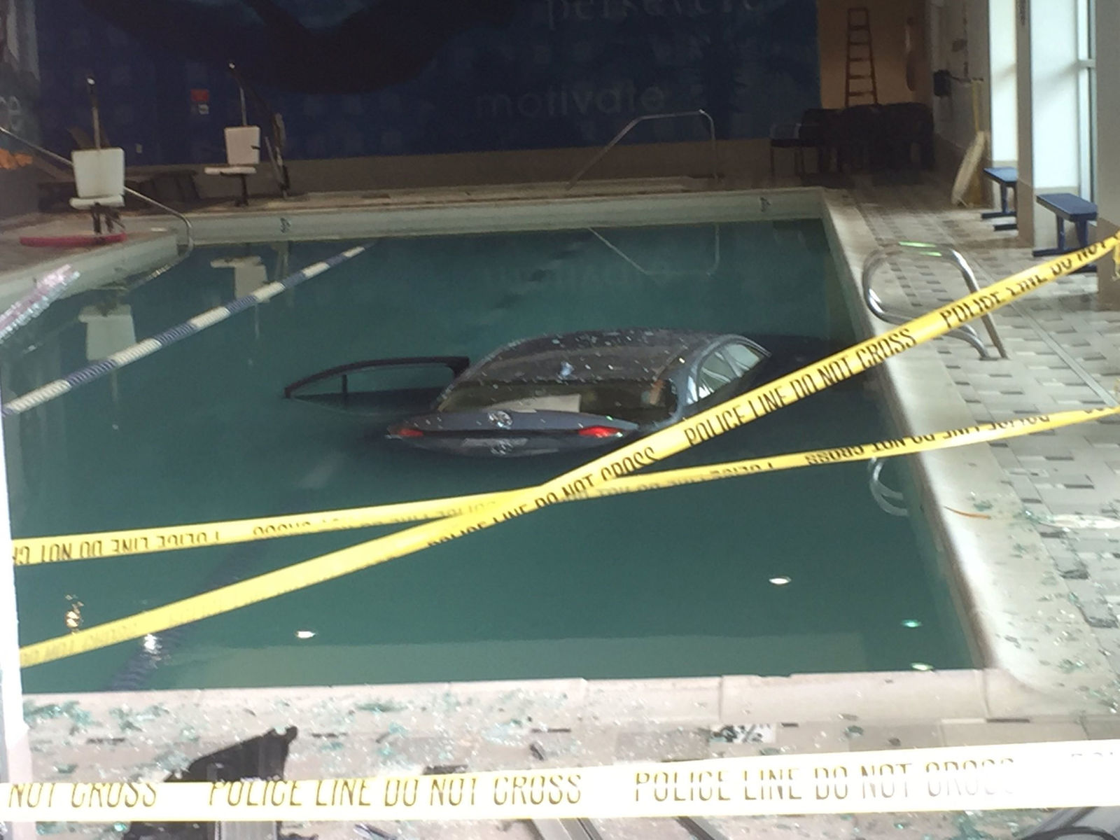 The car sunk to the bottom of the swimming pool at the LA Fitness facility in North Seattle. (KOMO News photo)