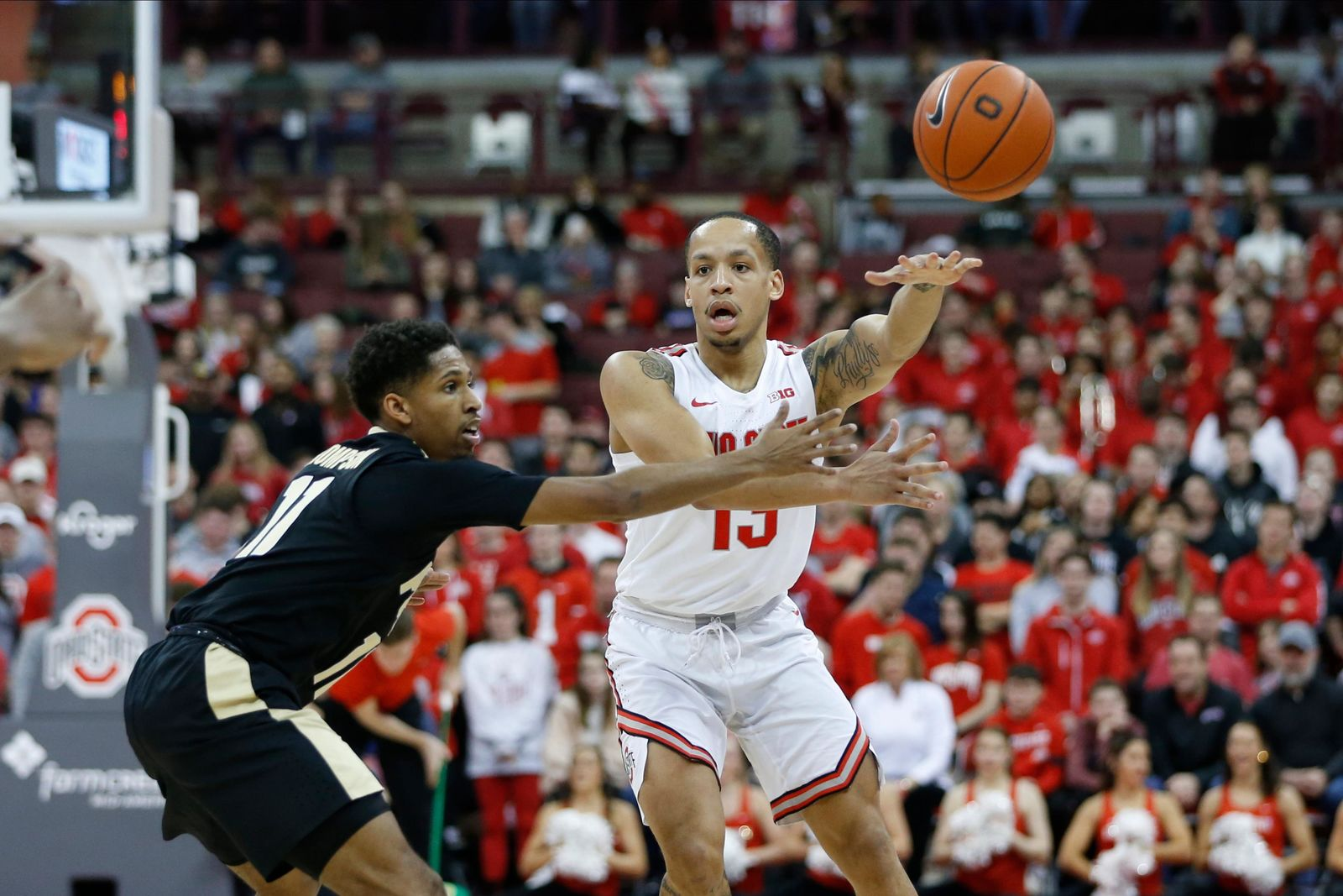 Ohio State's C.J. Walker, right, passes the ball as Purdue's Isaiah Thompson defends during the second half of an NCAA college basketball game Saturday, Feb. 15, 2020, in Columbus, Ohio. Ohio State beat Purdue 68-52. (AP Photo/Jay LaPrete)
