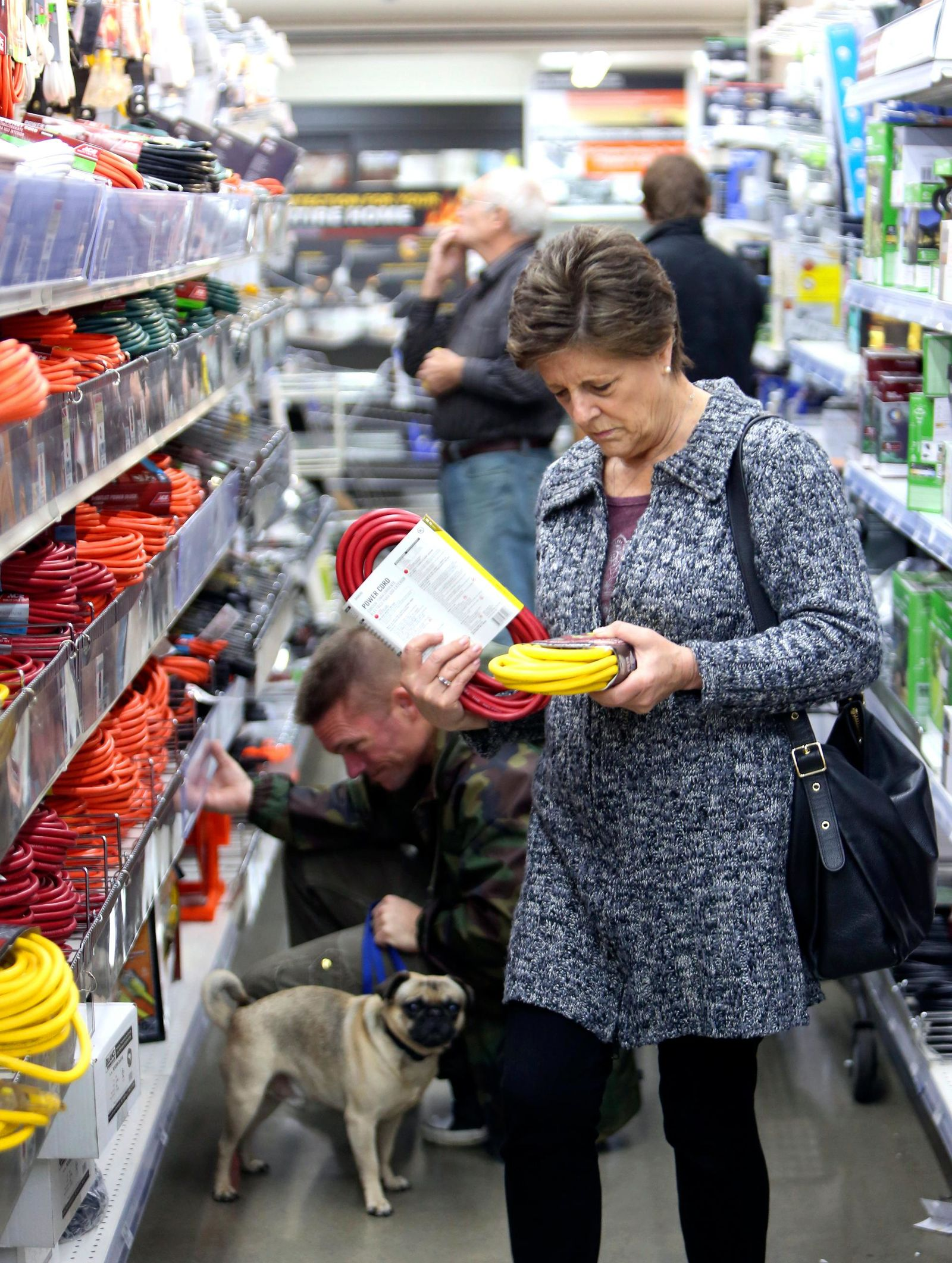 A shopper looks at extension cords at B&C Ace hardware store, Tuesday, Nov. 19, 2019, in Grass Valley, Calif., in preparation of the planned Pacific Gas & Electric power shutdown scheduled for Wednesday and Thursday. (Elias Funez/The Union via AP)