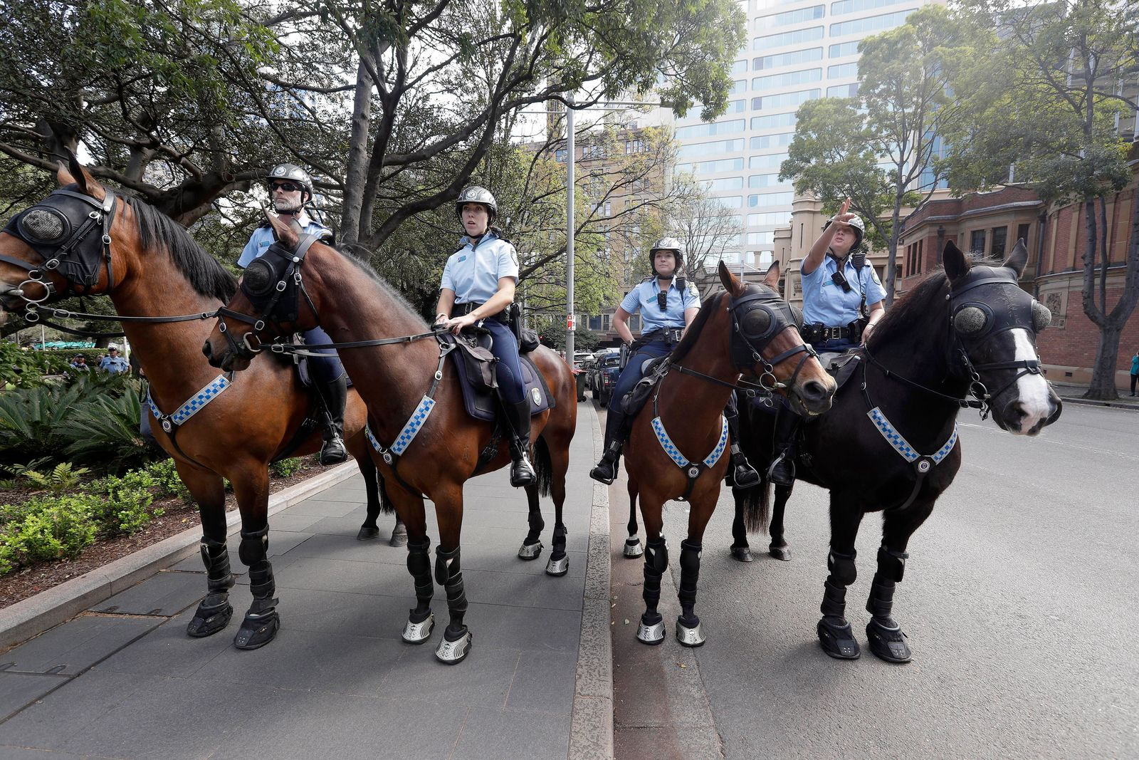 Mounted police block a path as thousands of protestors, many of them school students, attempt to march on the streets in Sydney, Friday, Sept. 20, 2019, calling for action to guard against climate change. (AP Photo/Rick Rycroft)