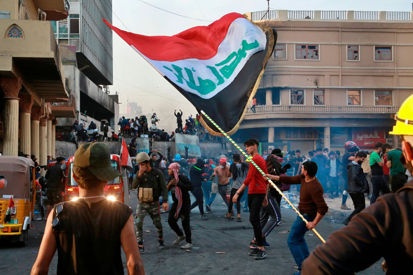 Anti-government protesters gather on Rasheed Street during clashes with security forces in Baghdad, Iraq, Thursday, Nov. 28, 2019. Scores of protesters have been shot dead in the last 24 hours, amid spiraling violence in Baghdad and southern Iraq, officials said. (AP Photo/Khalid Mohammed)