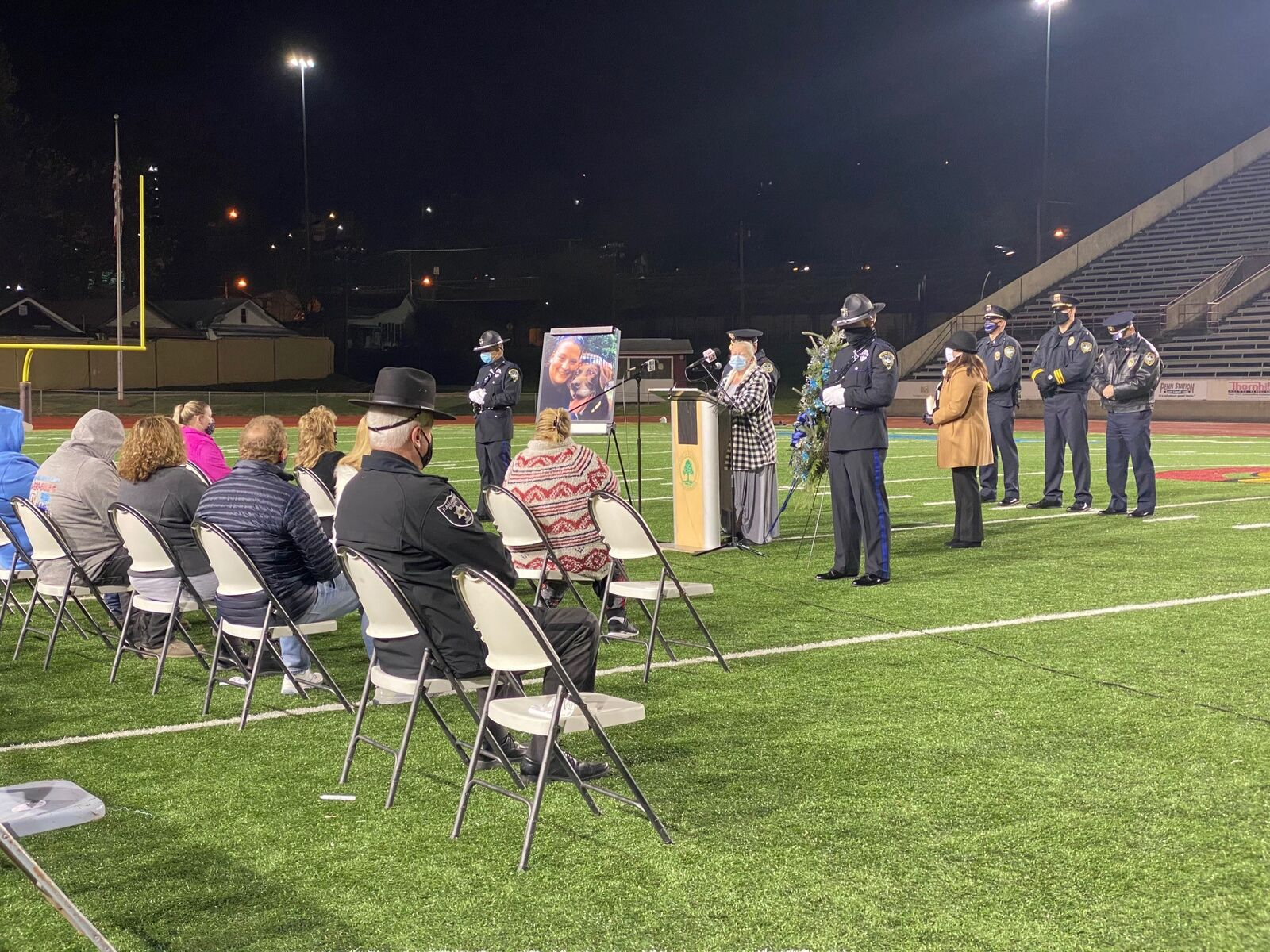 Officer Cassie Johnson's mother, Cheryl, talks to the crowd at a vigil at Laidley Field. (WCHS/WVAH)