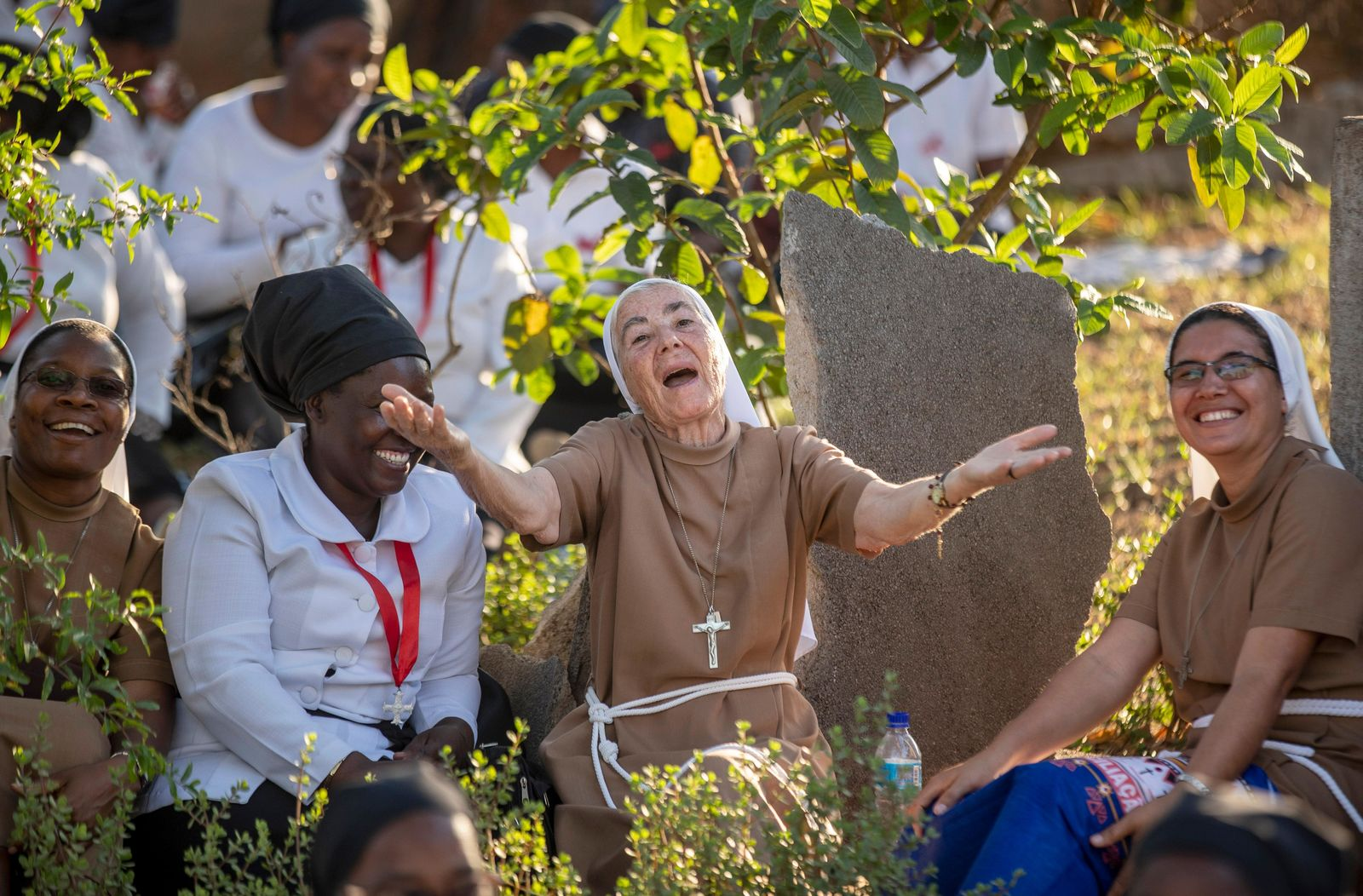 A nun gestures as she and others wait to see Pope Francis, ahead of his expected arrival near to the Apostolic Nunciature in the capital Maputo, Mozambique Wednesday, Sept. 4, 2019. Pope Francis is opening a three-nation pilgrimage to southern Africa with a strategic visit to Mozambique, just weeks after the country's ruling party and armed opposition signed a new peace deal and weeks before national elections. (AP Photo/Ben Curtis)