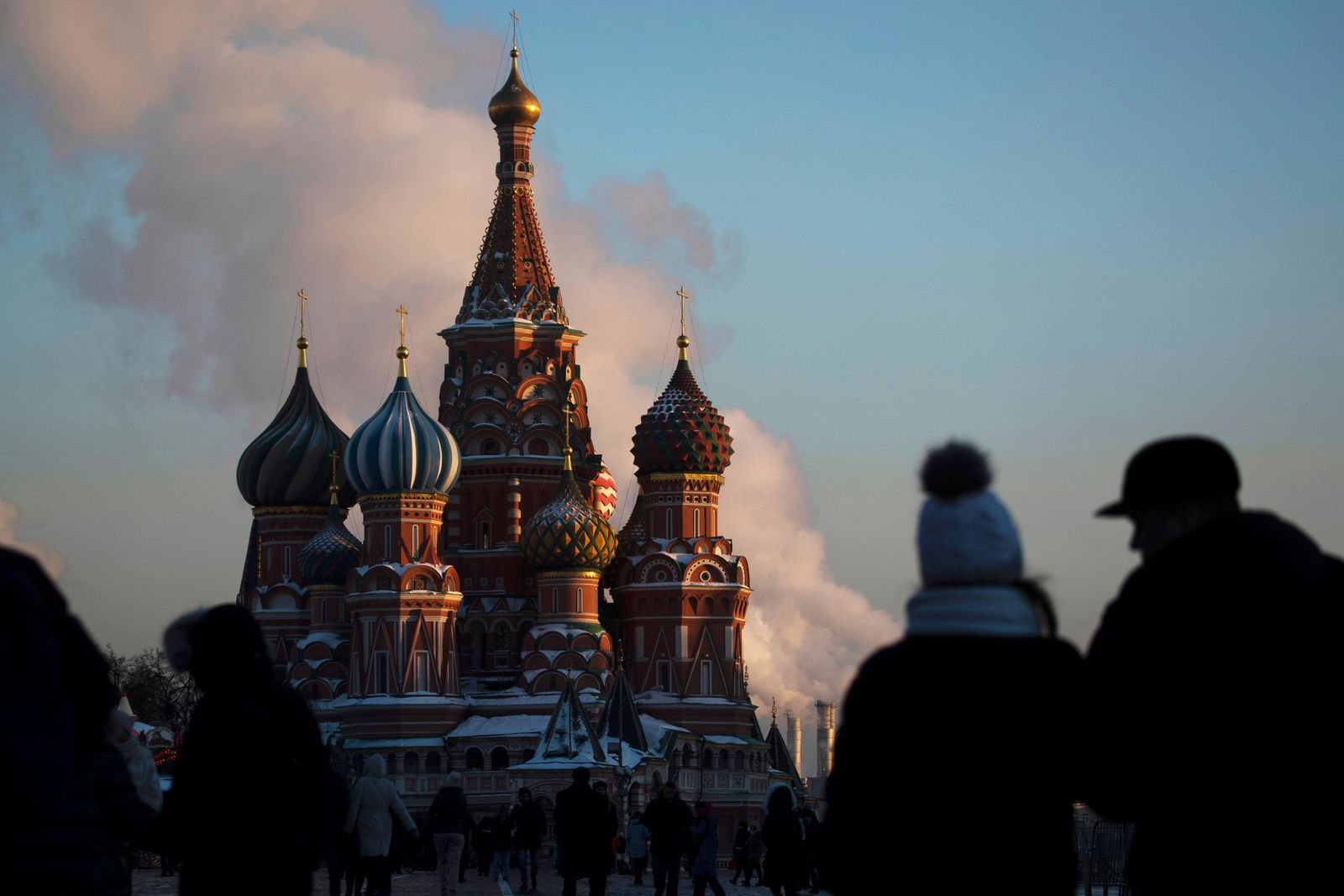 FILE - In this Thursday, Jan. 24, 2019 file photo, people walk in Red Square on a cold day, with St. Basil's Cathedral in the background, in Moscow, Russia. (AP Photo/Pavel Golovkin, File)