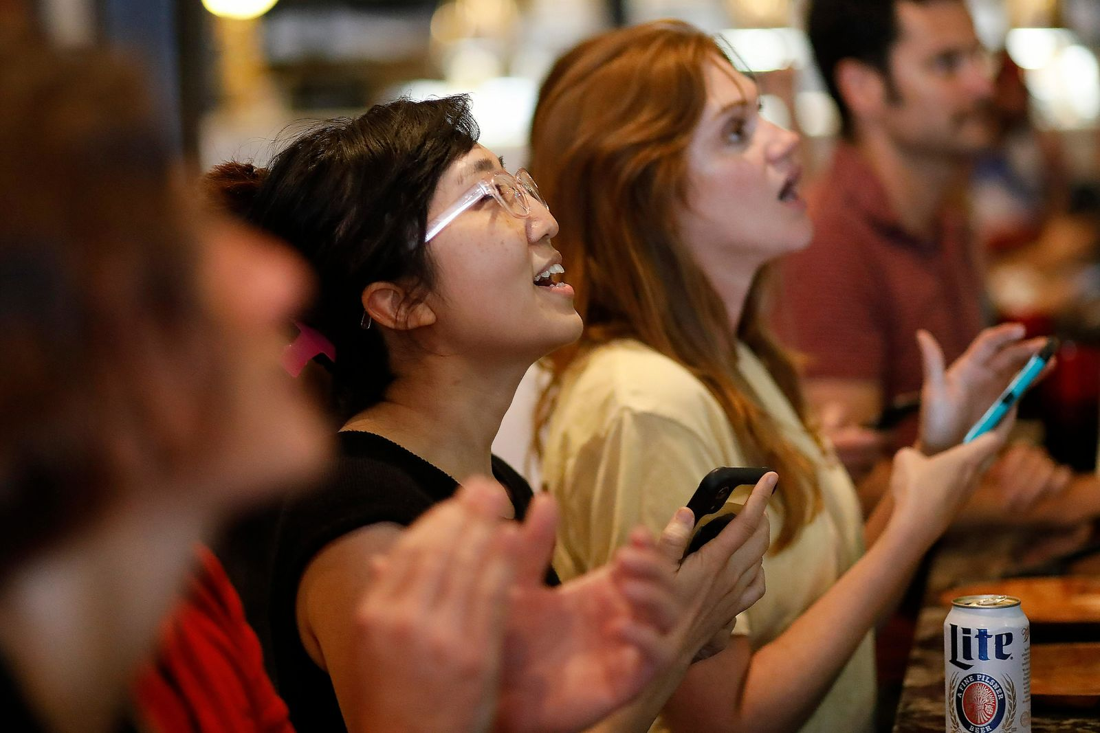 Fans watch television coverage of the United States' match against Thailand in France at soccer's Women's World Cup, Thursday, June 11, 2019, in Athens, Ga. (Joshua L. Jones/Athens Banner-Herald via AP)