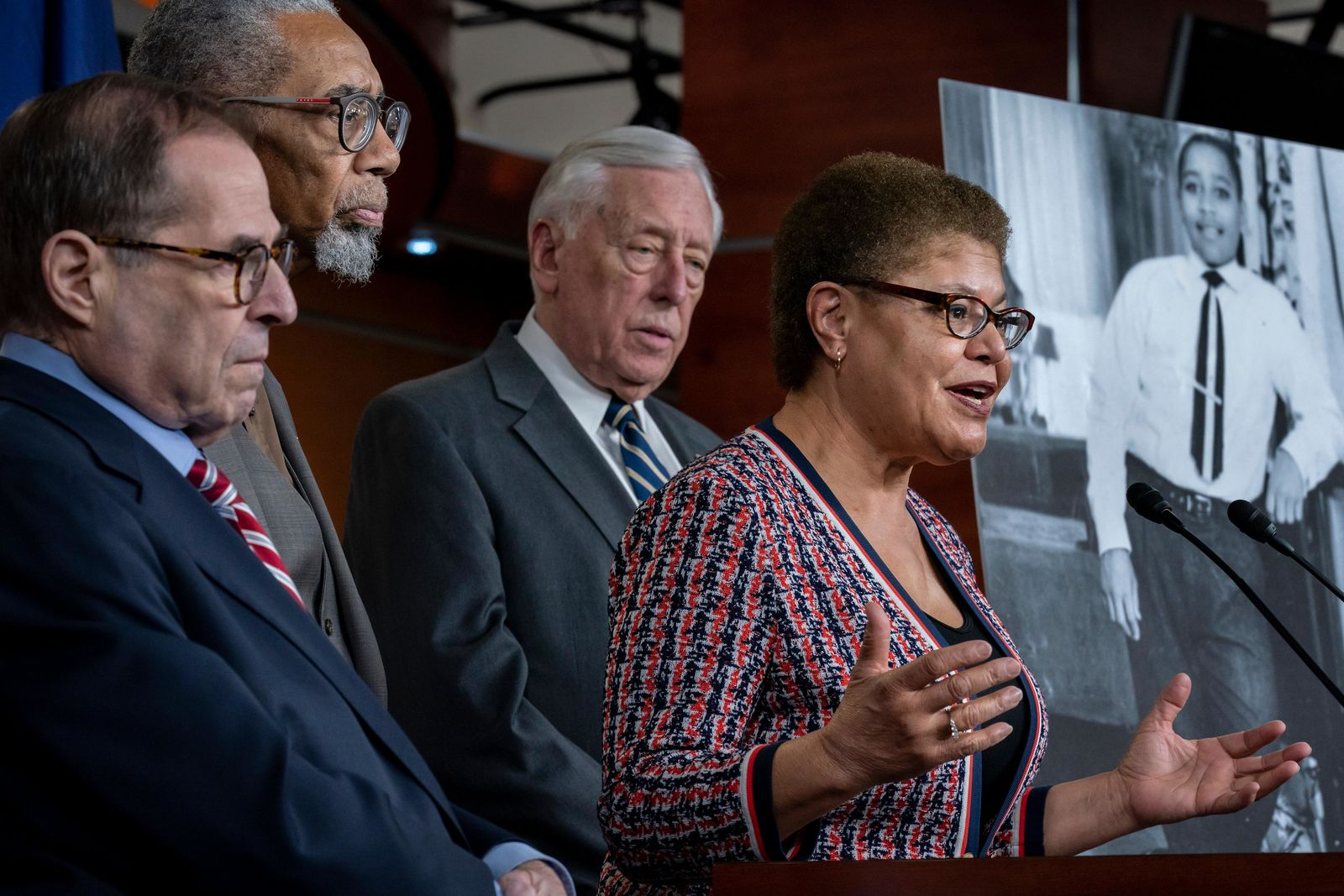 "From left, House Judiciary Committee Chairman Jerrold Nadler, D-N.Y., Rep. Bobby Rush, D-Ill., House Majority Leader Steny Hoyer, D-Md., and Rep. Karen Bass, D-Calif., chair of the Congressional Black Caucus, hold a news conference to discuss the ""Emmett Till Antilynching Act"" which would designate lynching as a hate crime under federal law, on Capitol Hill in Washington, Wednesday, Feb. 26, 2020. Emmett Till, pictured at right, was a 14-year-old African-American who was lynched in Mississippi in 1955, after being accused of offending a white woman in her family's grocery store. (AP Photo/J. Scott Applewhite)"