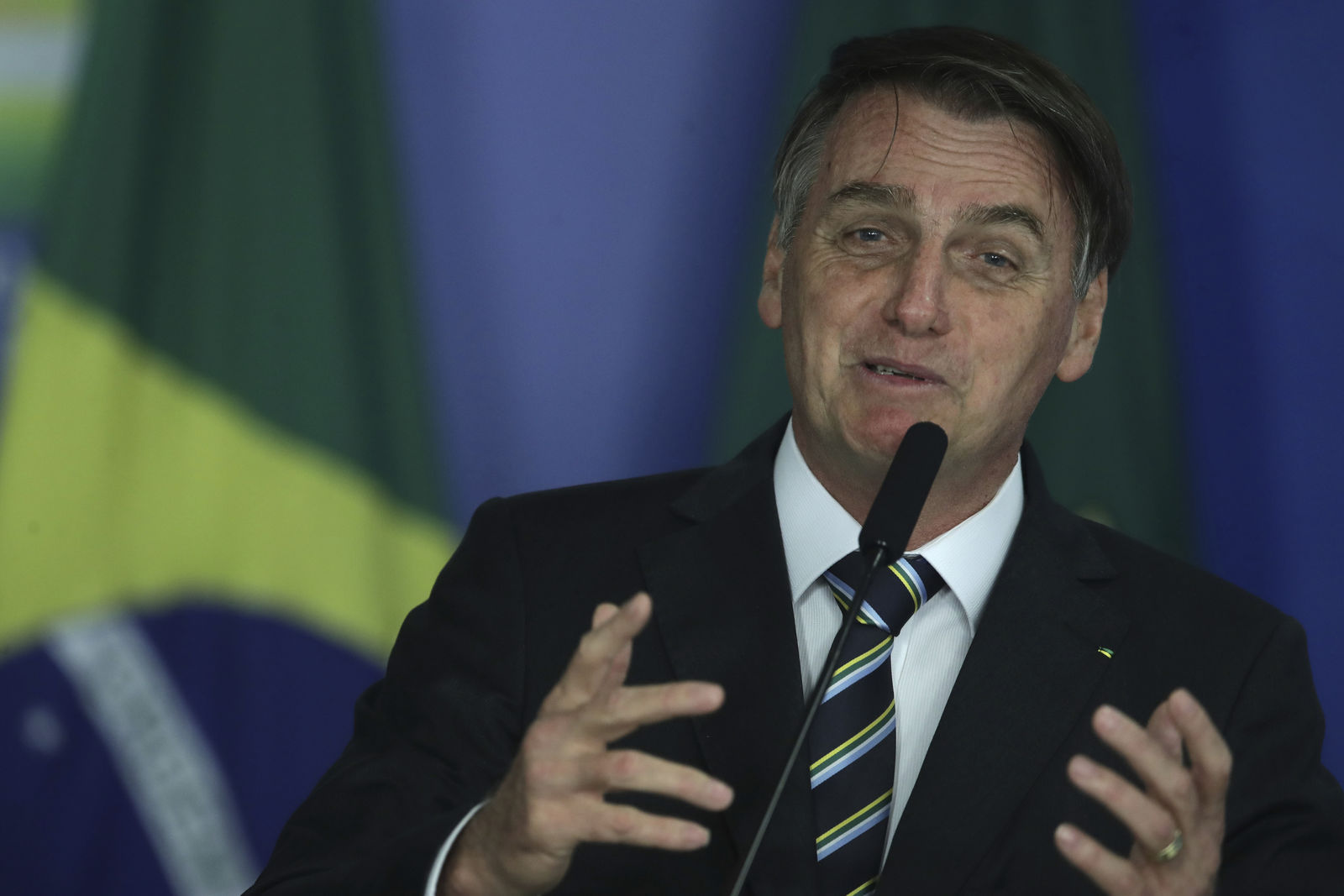 Brazil's President Jair Bolsonaro speaks during an event at the Planalto Presidential Palace, in Brasilia, Brazil, Tuesday, April 30, 2019. Bolsonaro convened a meeting of top ministers to discuss the ongoing situation in Venezuela. (AP Photo/Eraldo Peres)