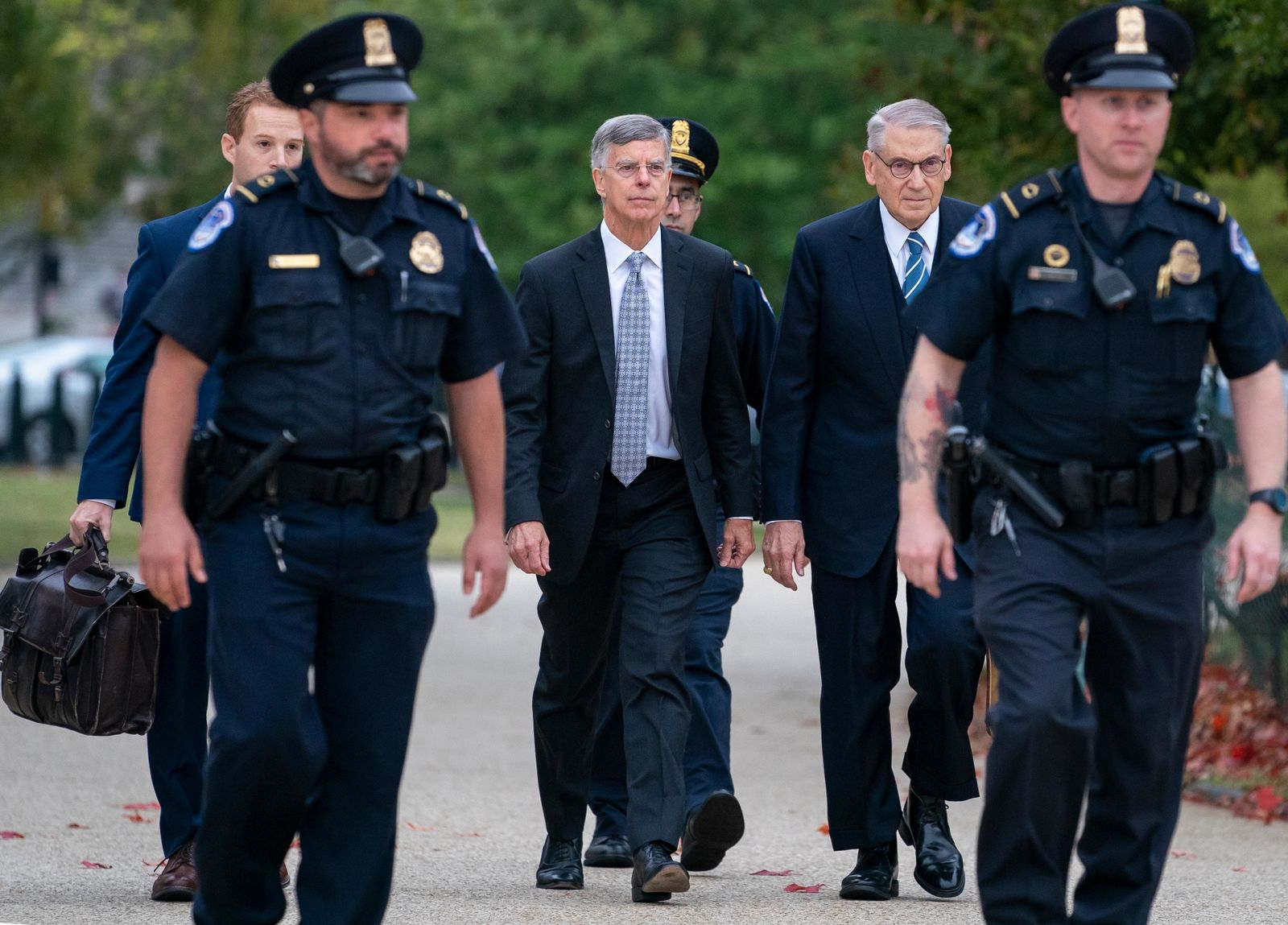 Ambassador William Taylor is escorted by U.S. Capitol Police as he arrives to testify before House committees as part of the Democrats' impeachment investigation of President Donald Trump, at the Capitol in Washington, Tuesday, Oct. 22, 2019.  (AP Photo/J. Scott Applewhite)