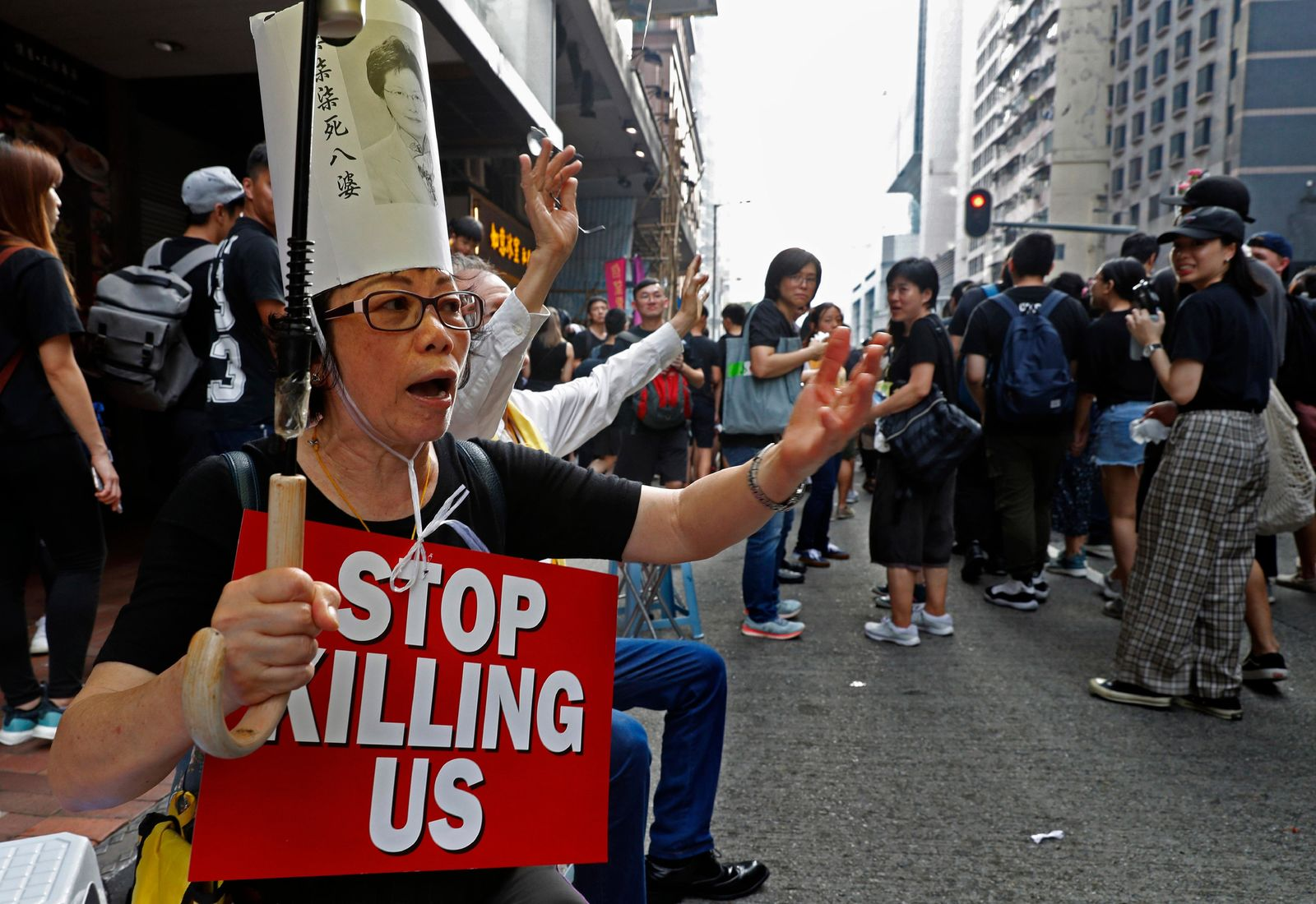 Protesters raise placards as they march on the streets against an extradition bill in Hong Kong on Sunday, June 16, 2019.