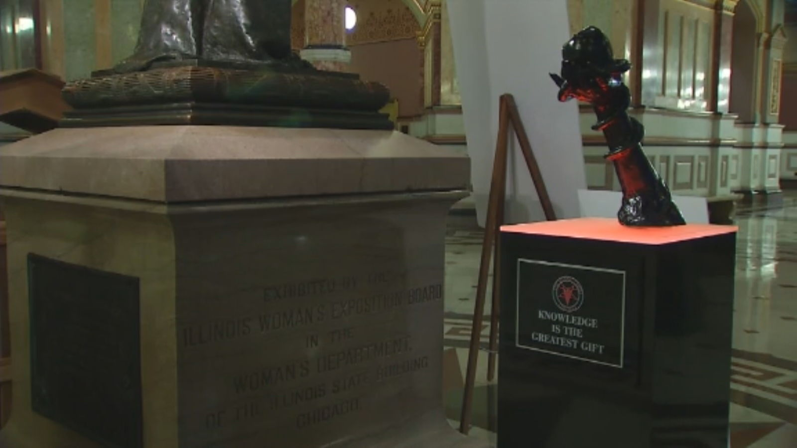 A local chapter of The Satanic Temple has been allowed to place a statue in the Illinois Capitol alongside holiday displays of a Nativity scene and a menorah.